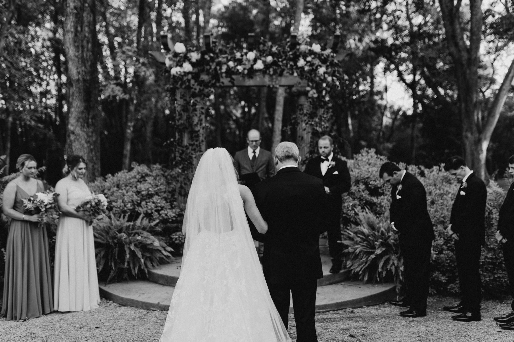 black and white photo of bride walking down the aisle with her dad