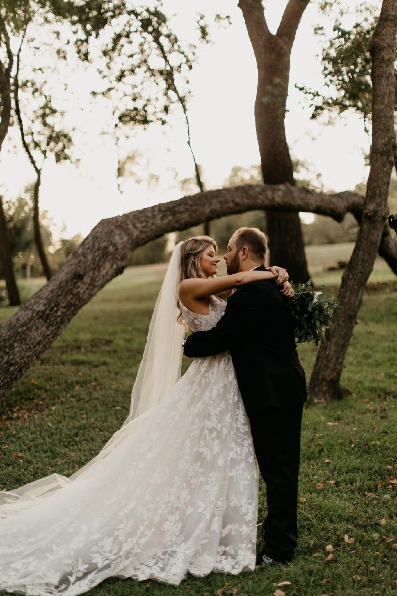perfect bride and groom photo in the middle of a forest