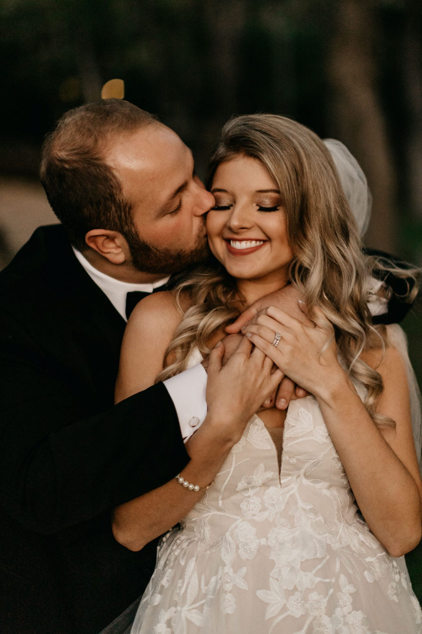 groom kissing bride on the cheek after wedding ceremony in Fort Worth