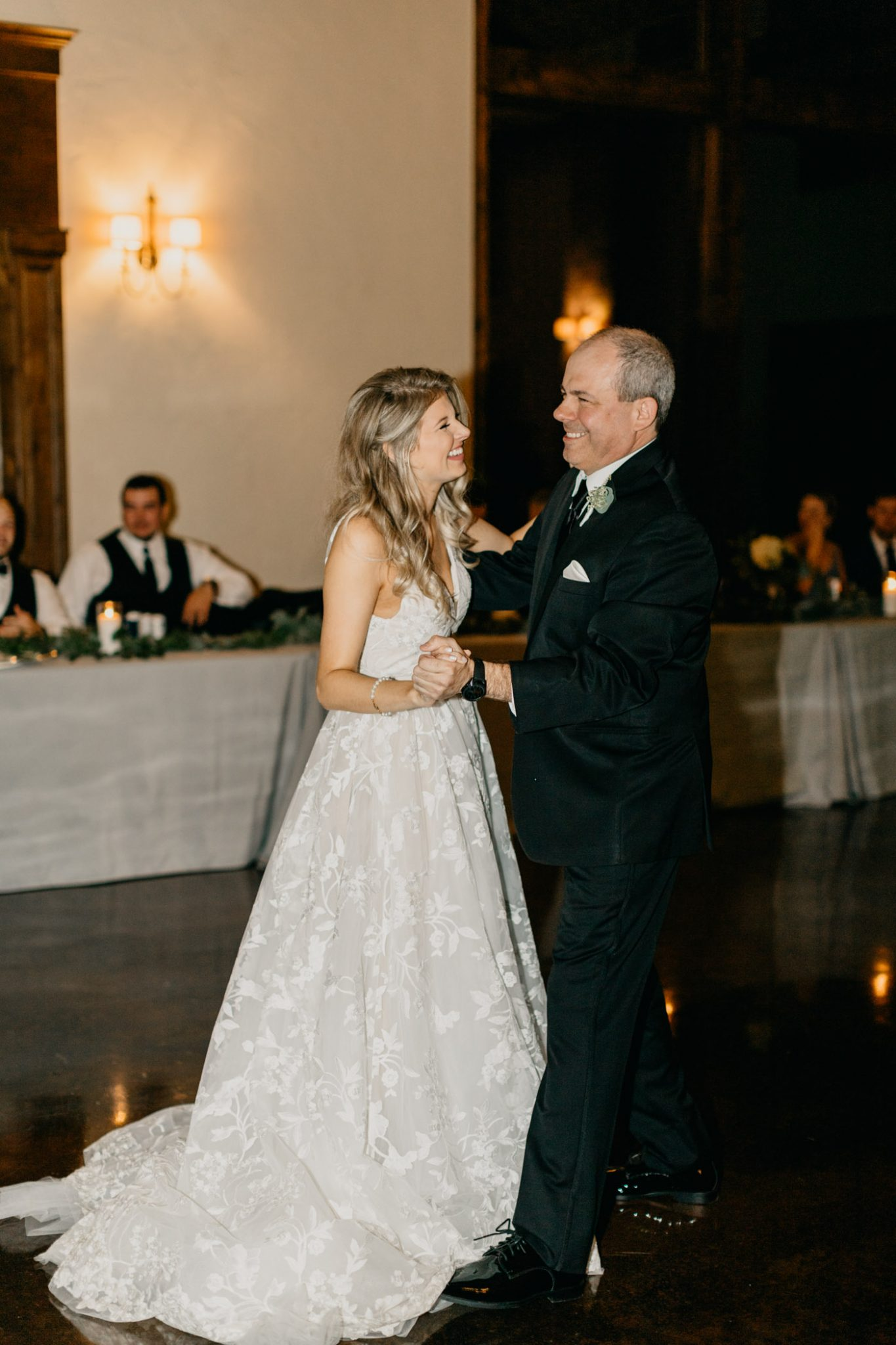 stunning bride dancing with her father on her wedding day