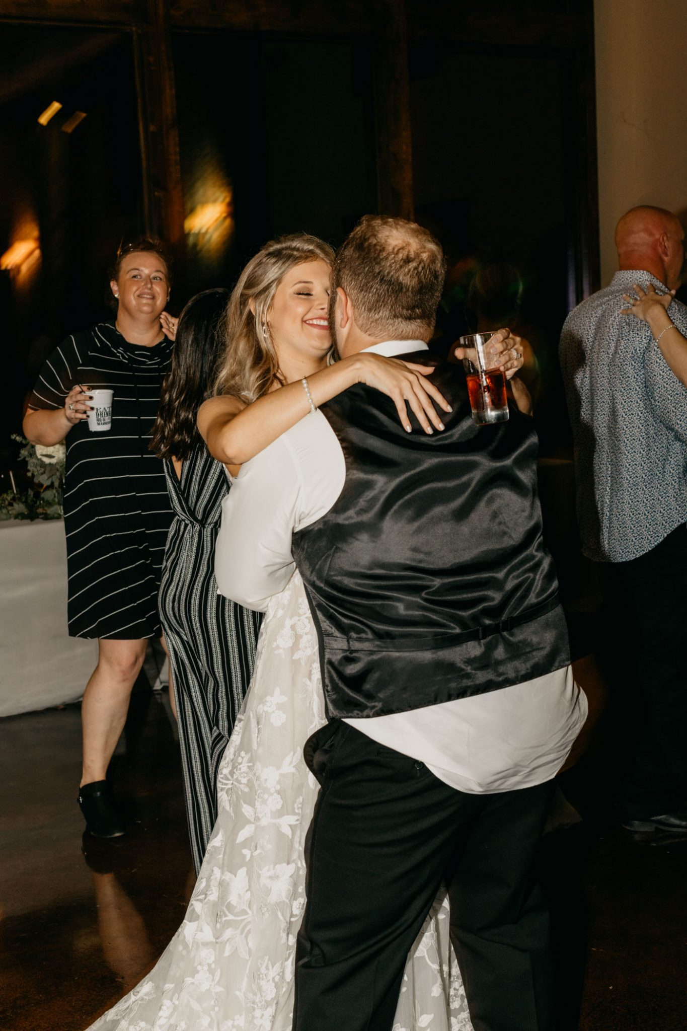 bride and groom having fun by dancing and celebrating their recent marriage
