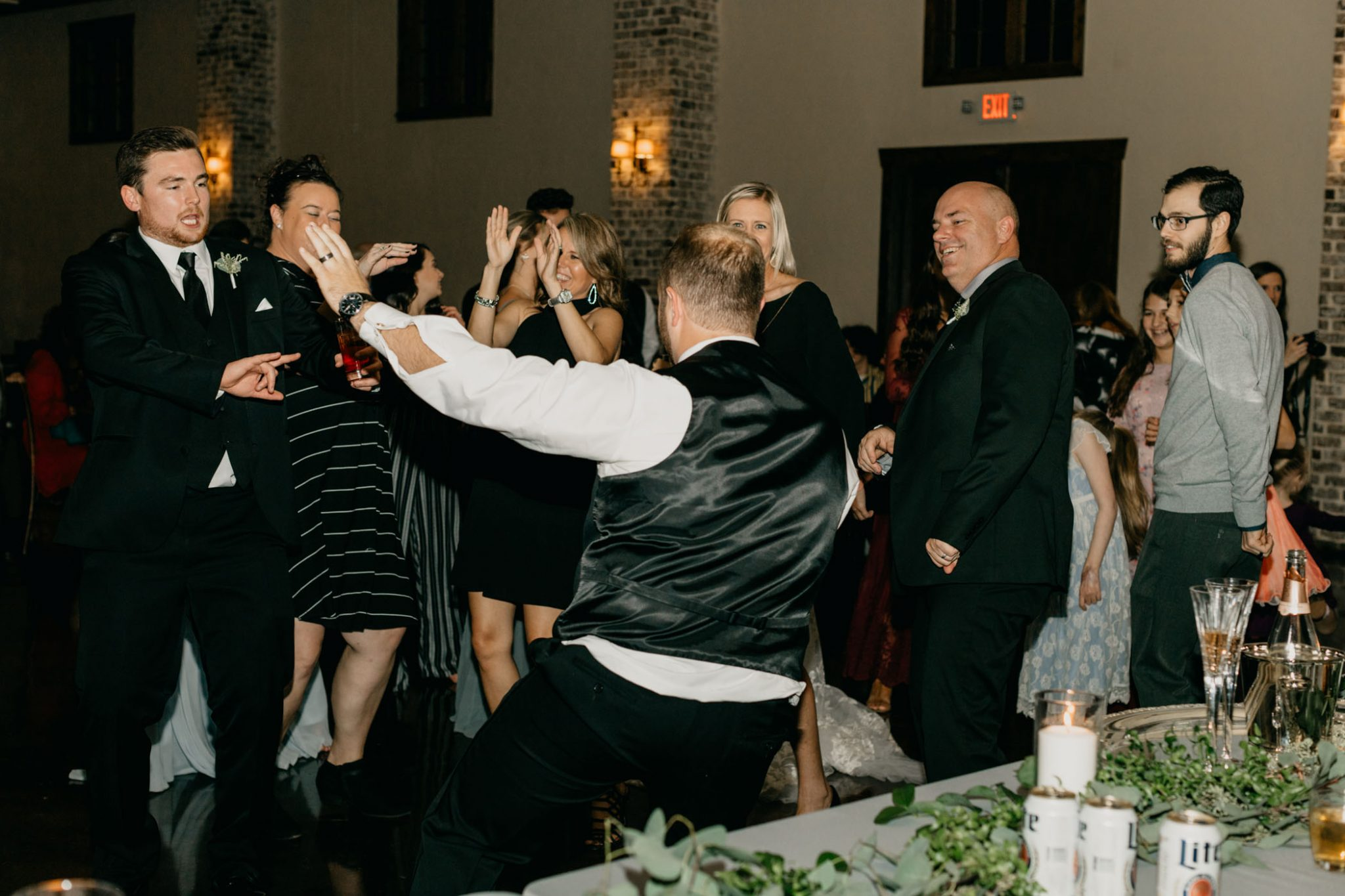 groom dancing and having fun at his wedding reception
