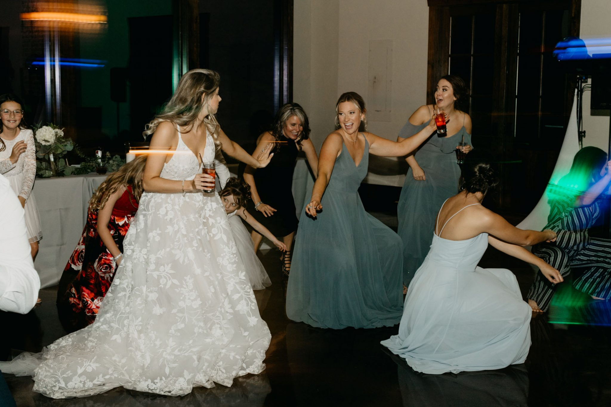 adorable bridal party dancing and having fun at a wedding reception