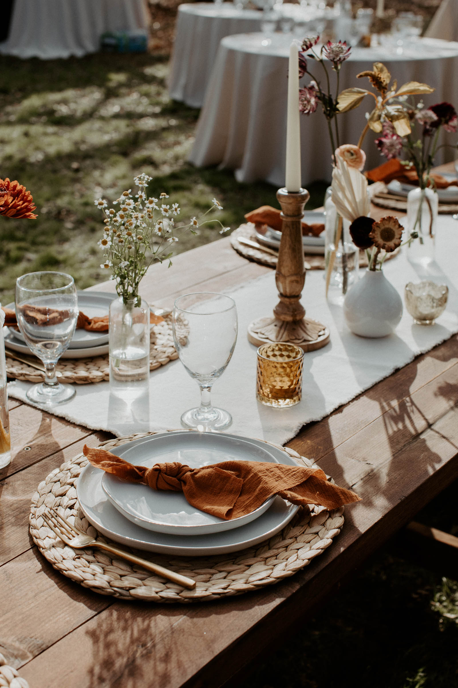 Bohemian fall wedding decor at casual backyard wedding
