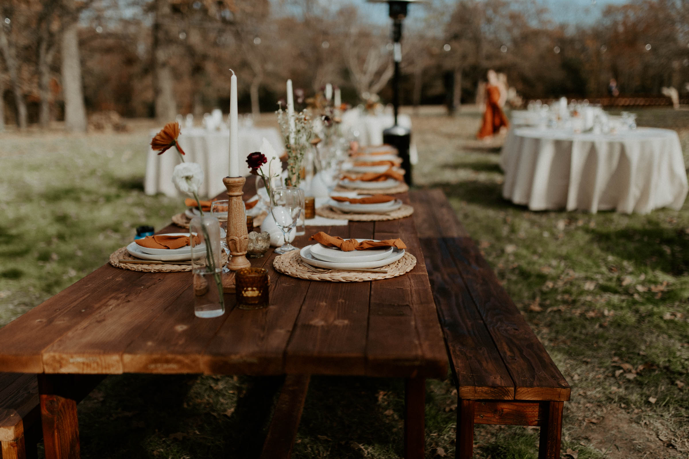 Wooden farm table with boho wedding decor for the fall