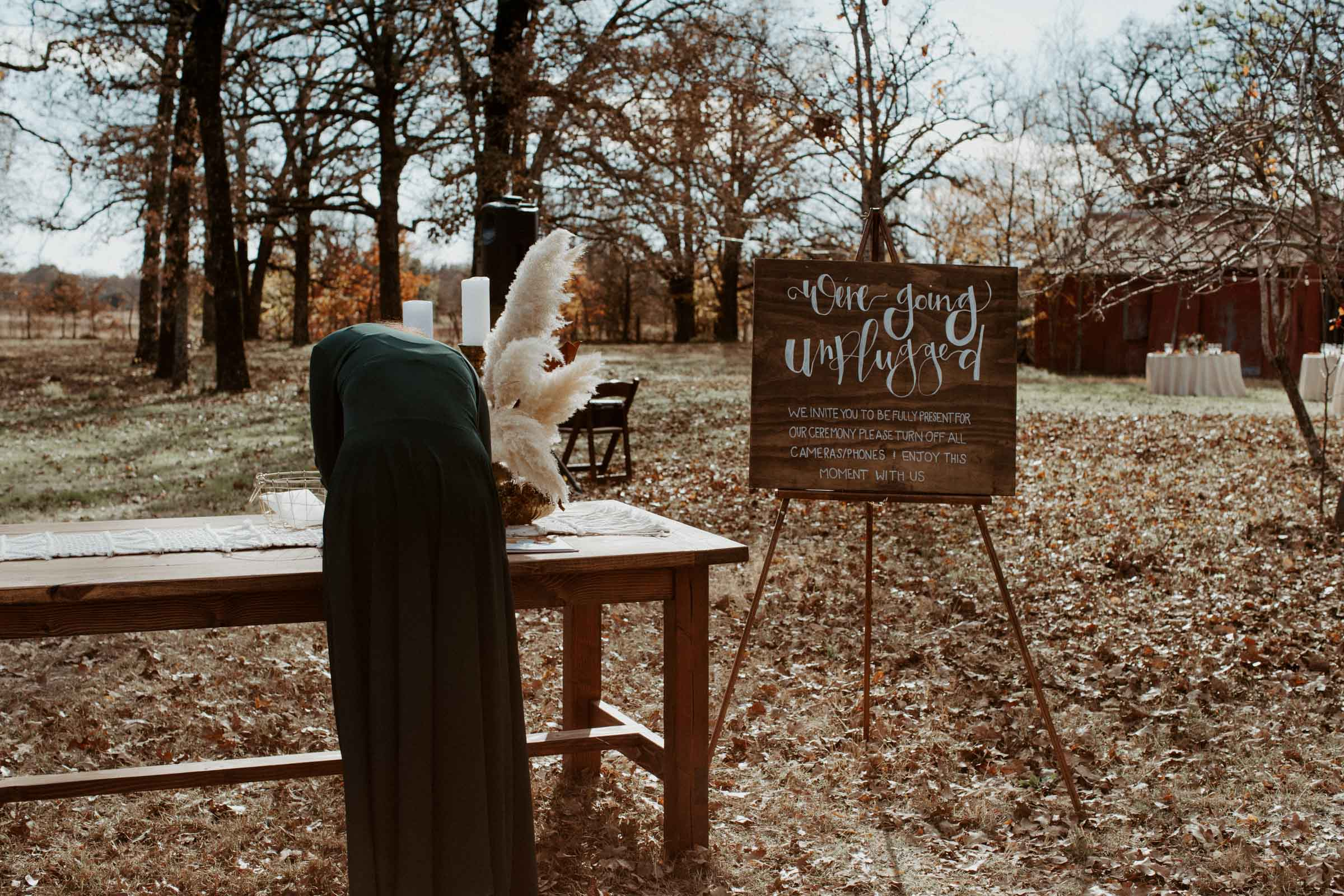 "Sign in table with ""unplugged"" wedding sign for ceremony"