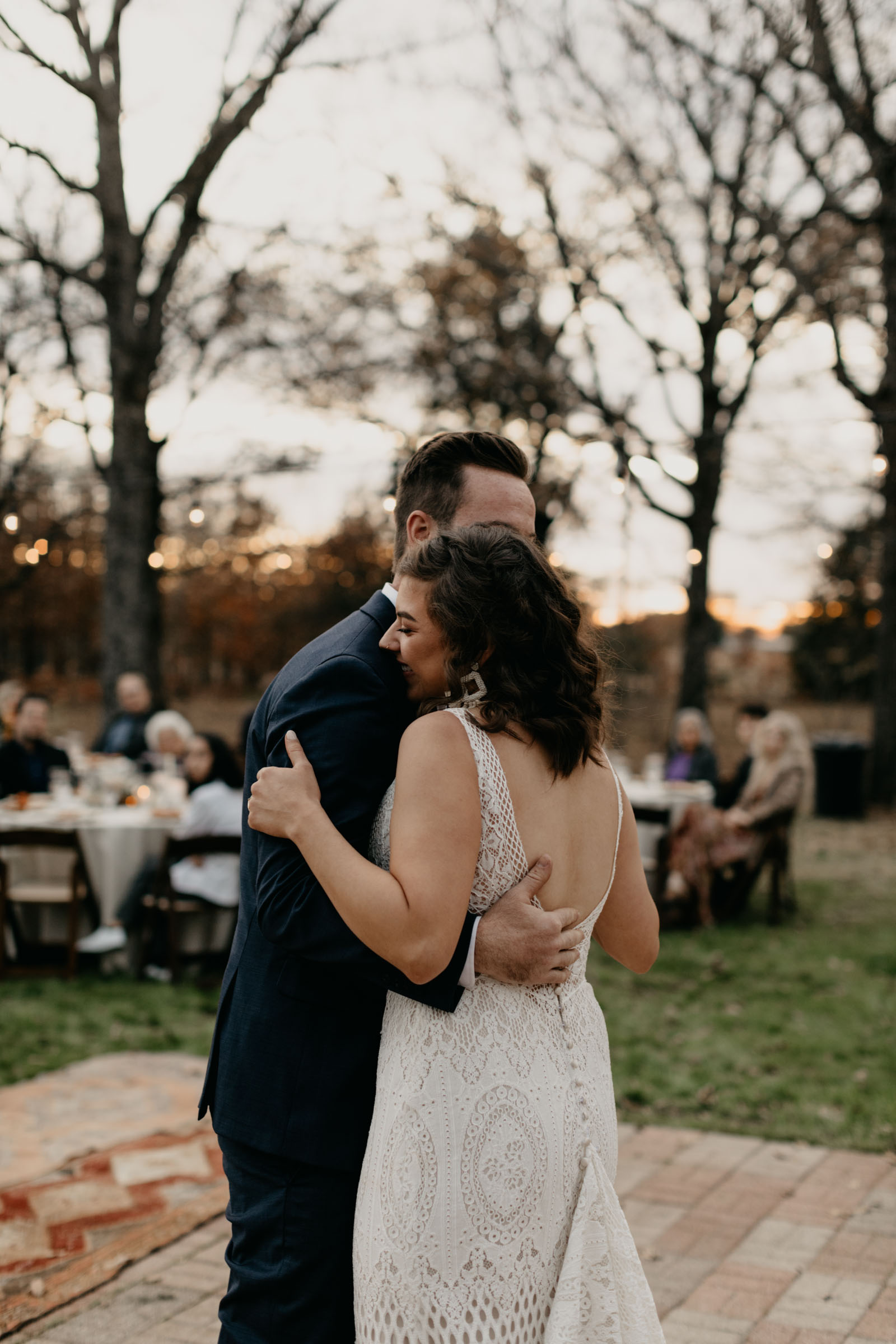 Bride and groom sharing romantic first dance outdoors