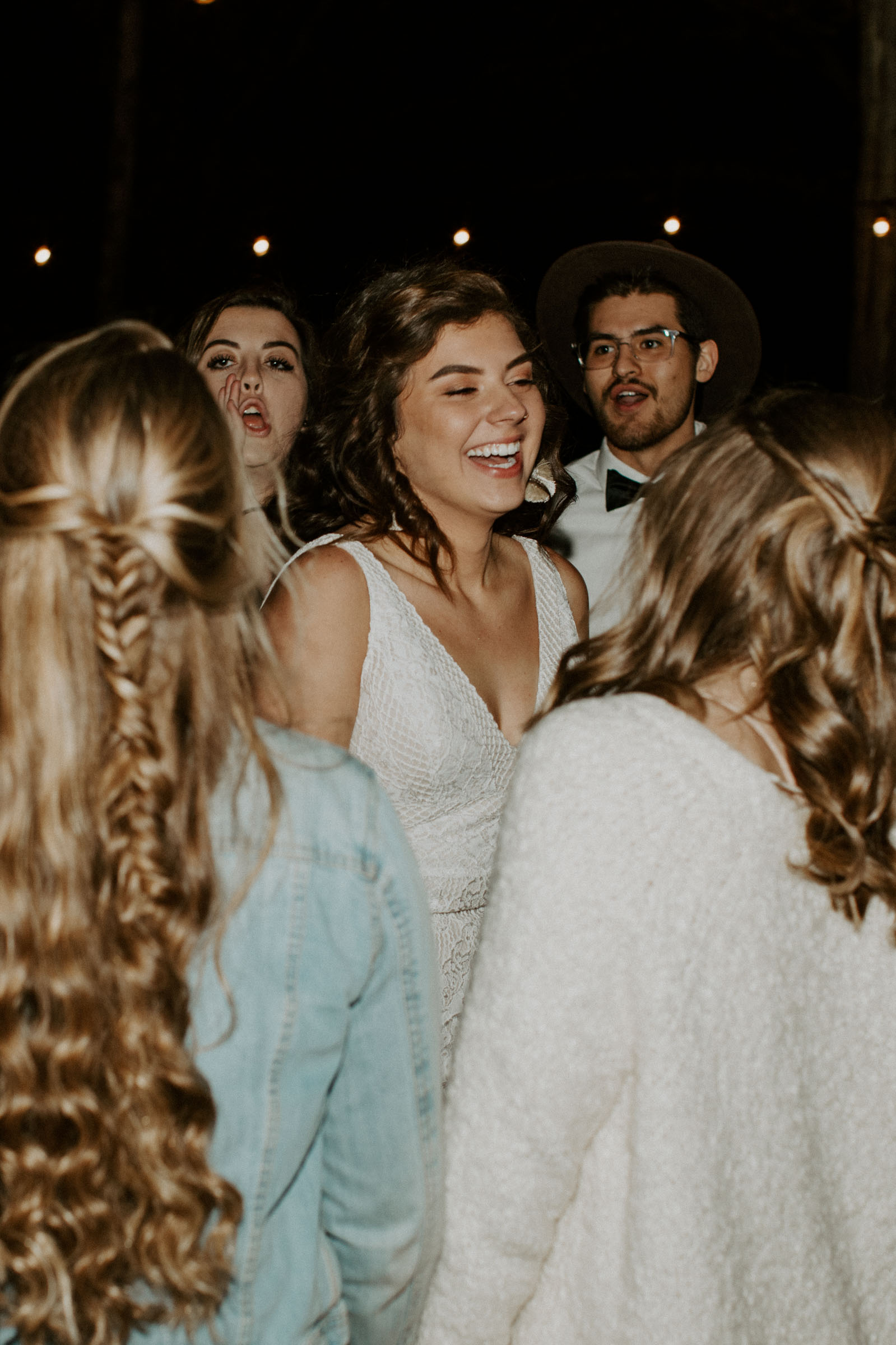Bride dancing with friends on her wedding day