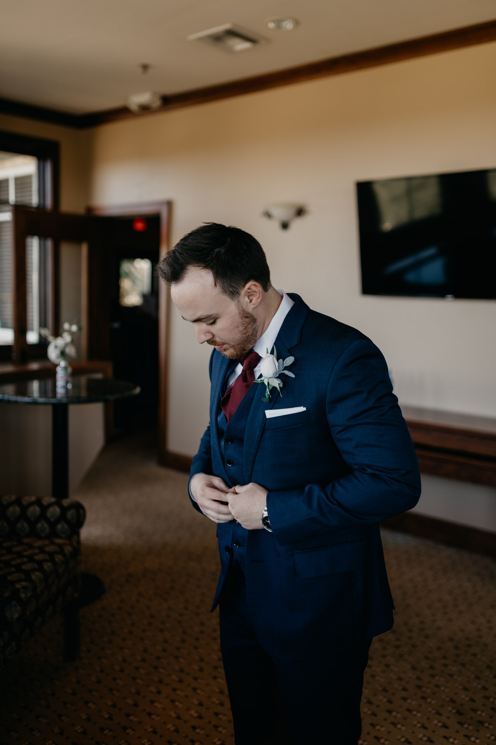 groom getting ready for wedding day in DFW