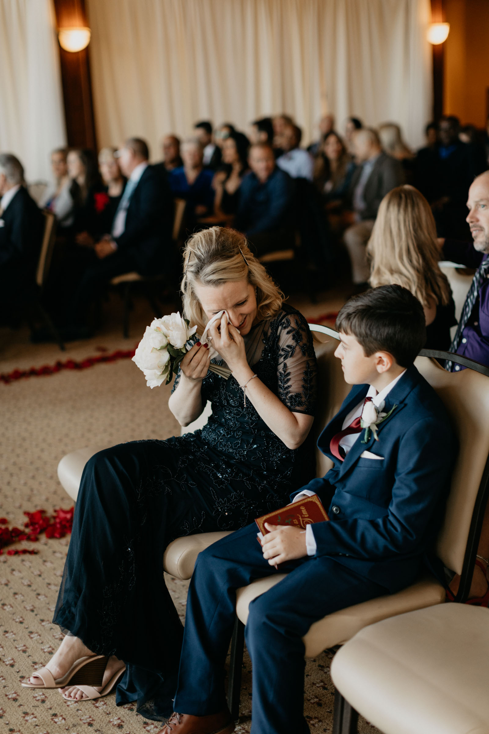 Emotional mom crying during daughters wedding ceremony