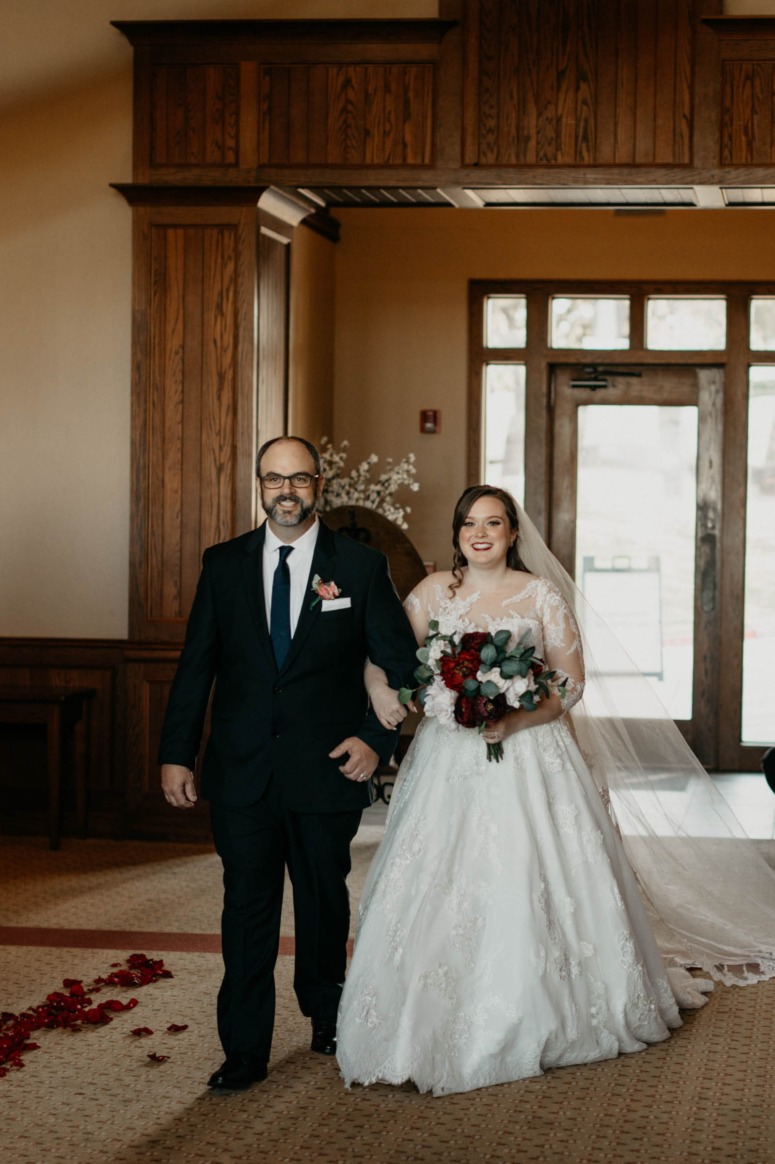 father walking his daughter down the aisle in DFW