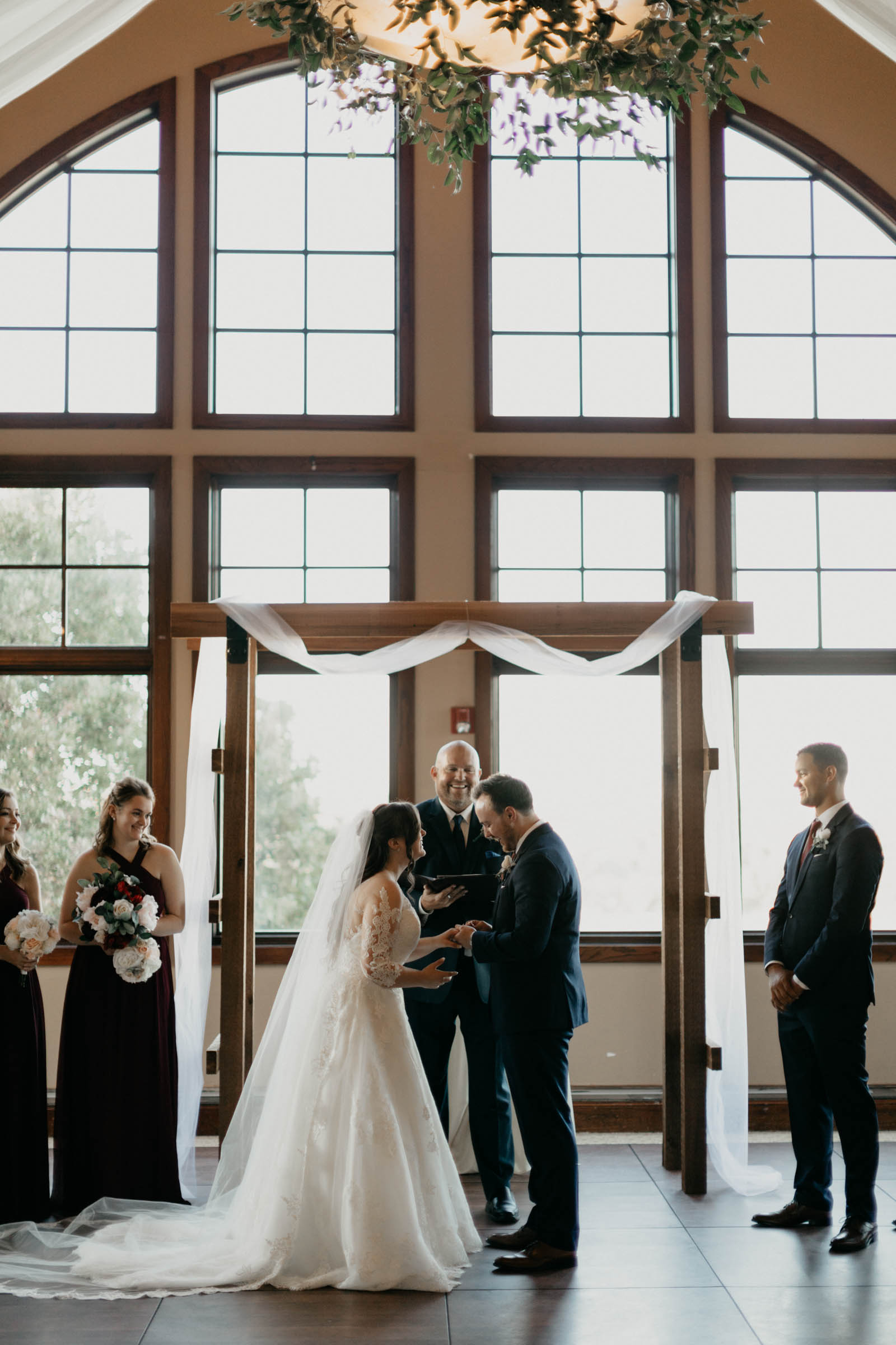 bride and groom standing at the altar during their wedding ceremony