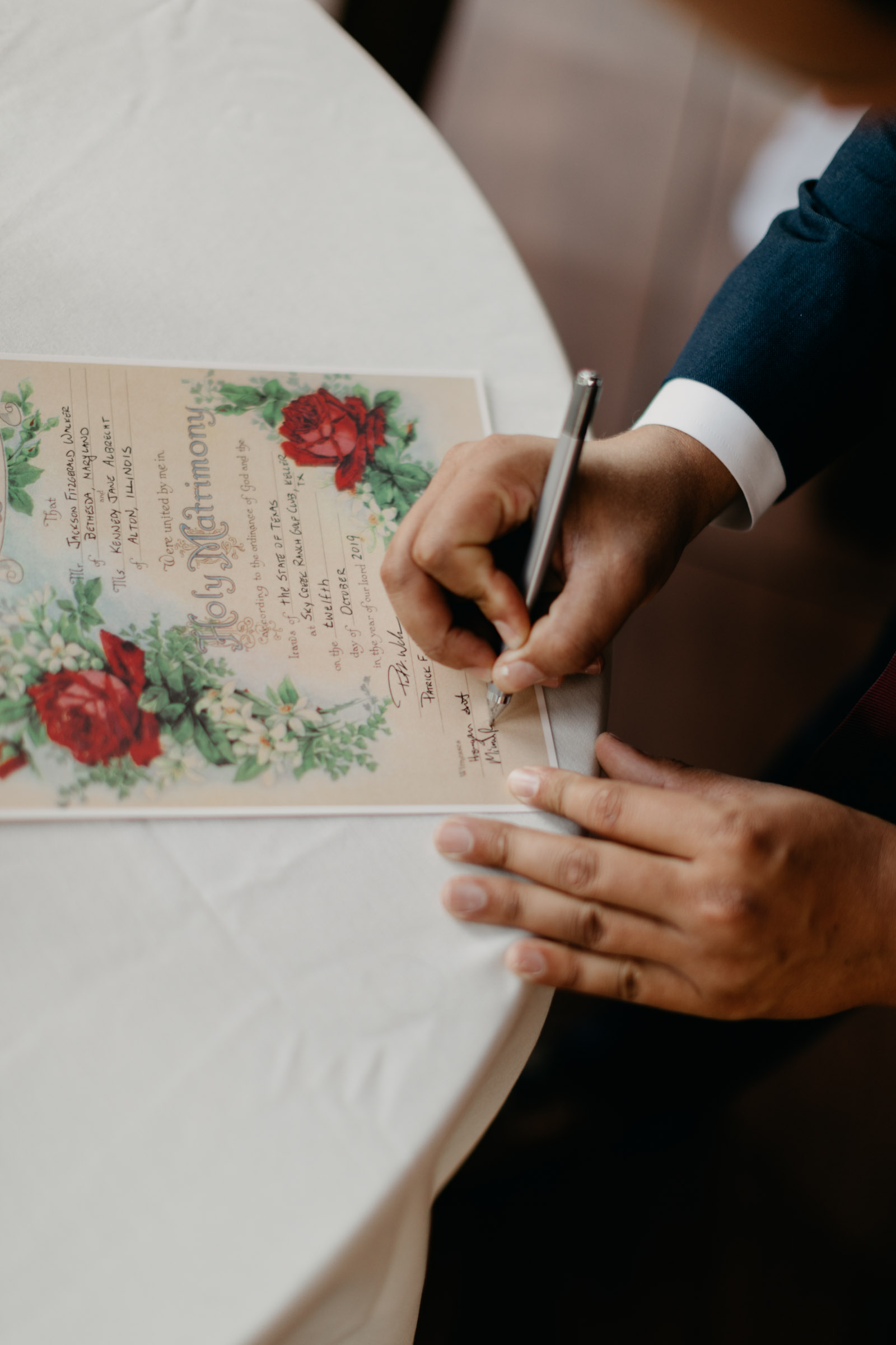 officiant signing Texas wedding license on wedding day