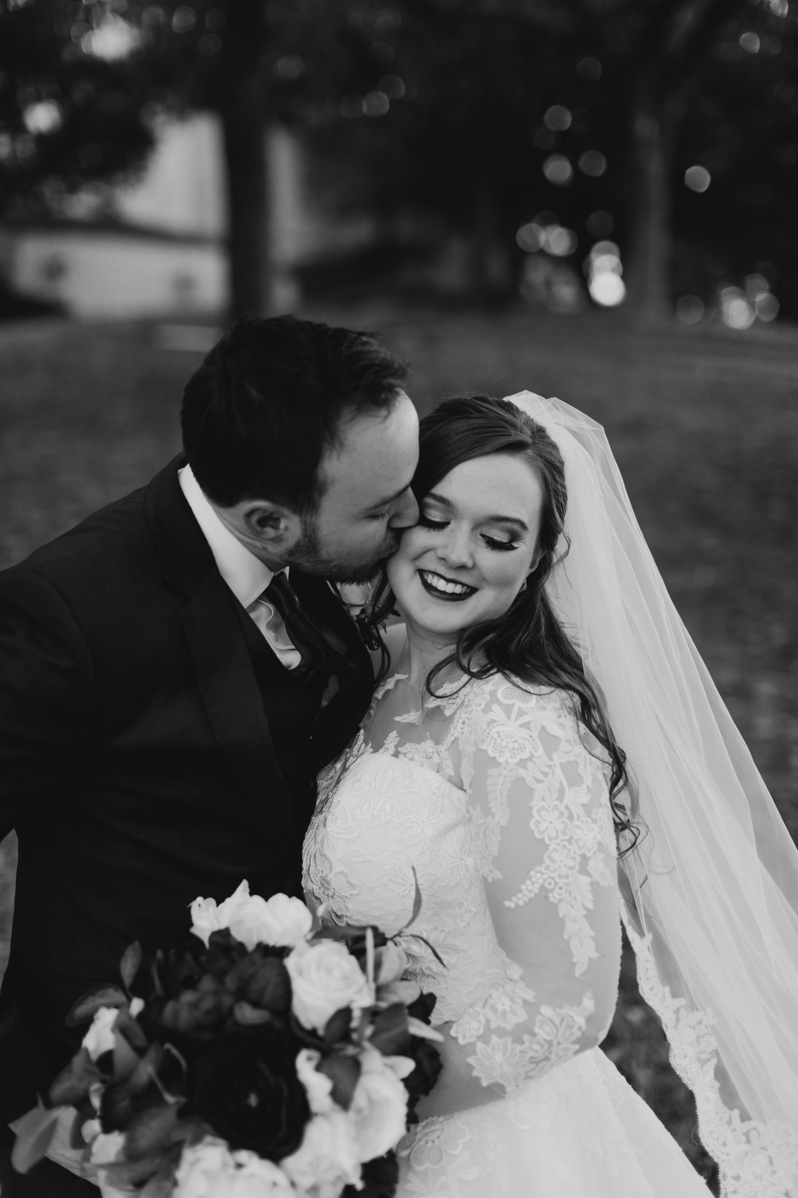 photographer takes photo of bride and groom after their traditional wedding day in DFW