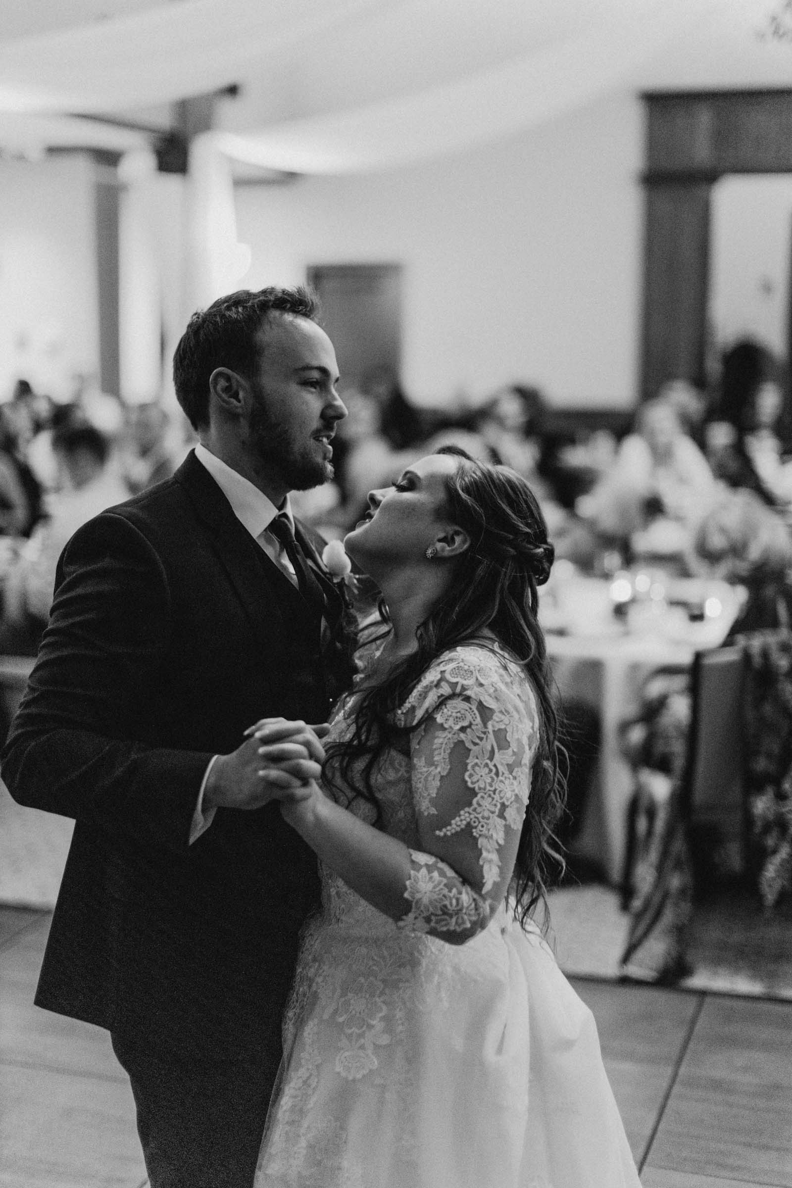 black and white photo of married couple sharing their first dance