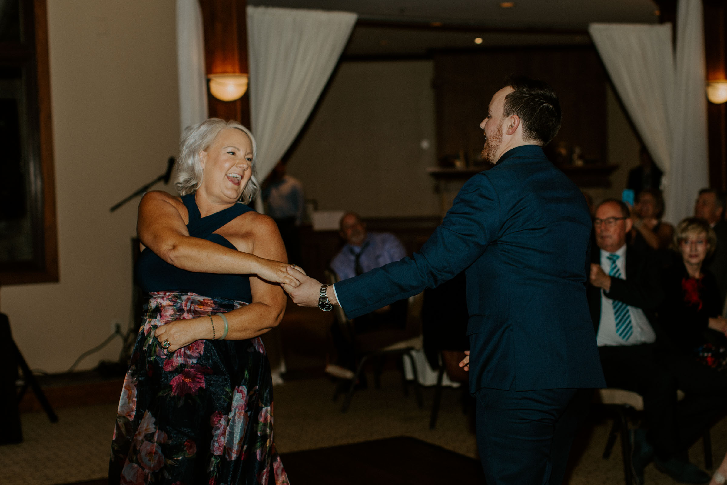 mother and son dancing on wedding day