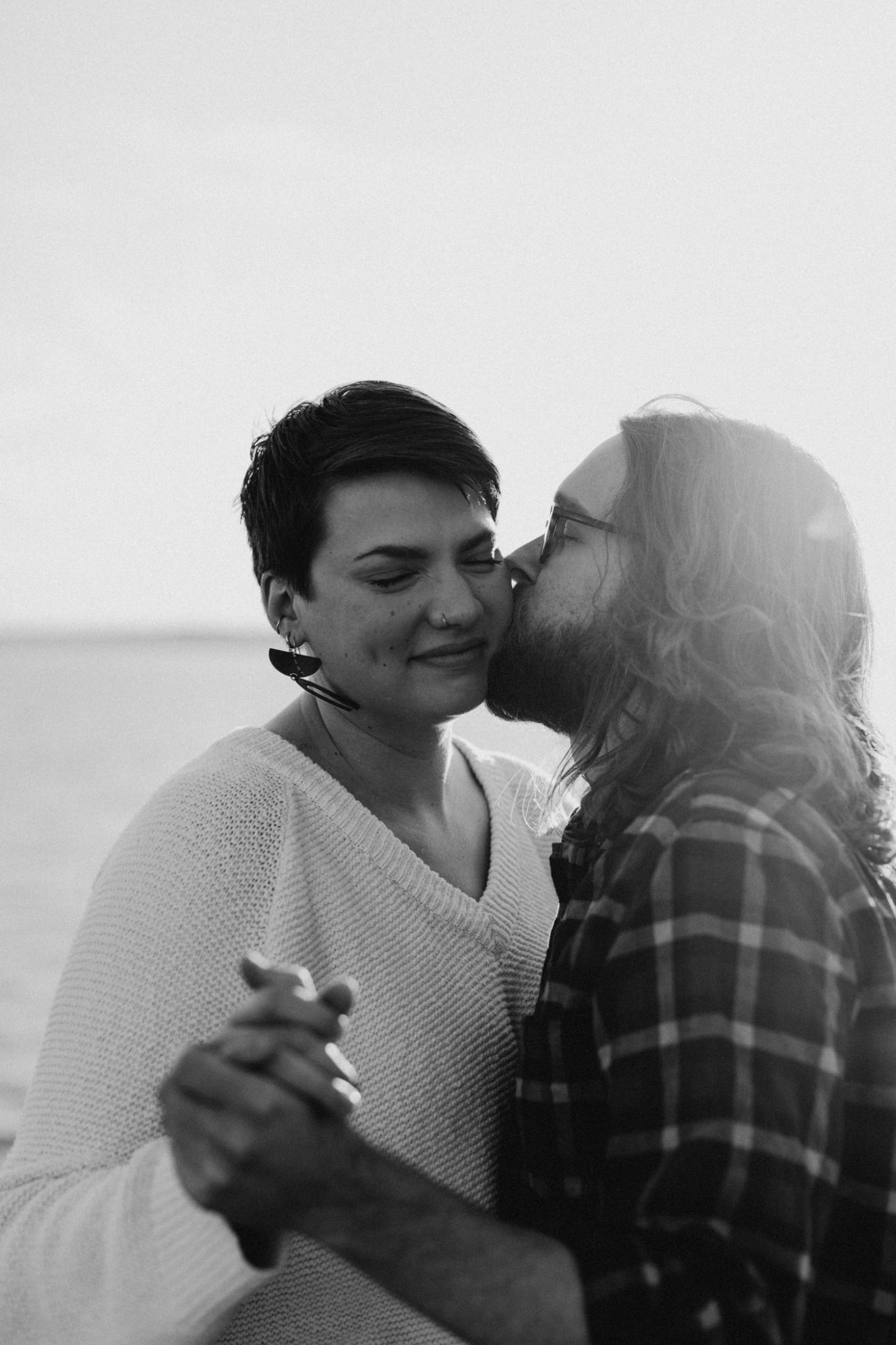 Black and white photo of hipster couple being romantic for their photography session in fort worth