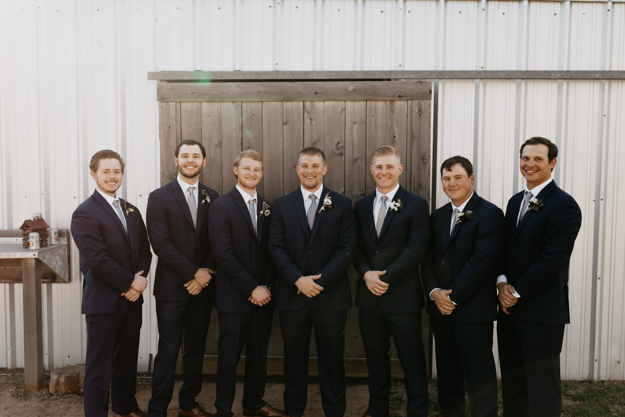 groomsmen standing in front of wedding venue