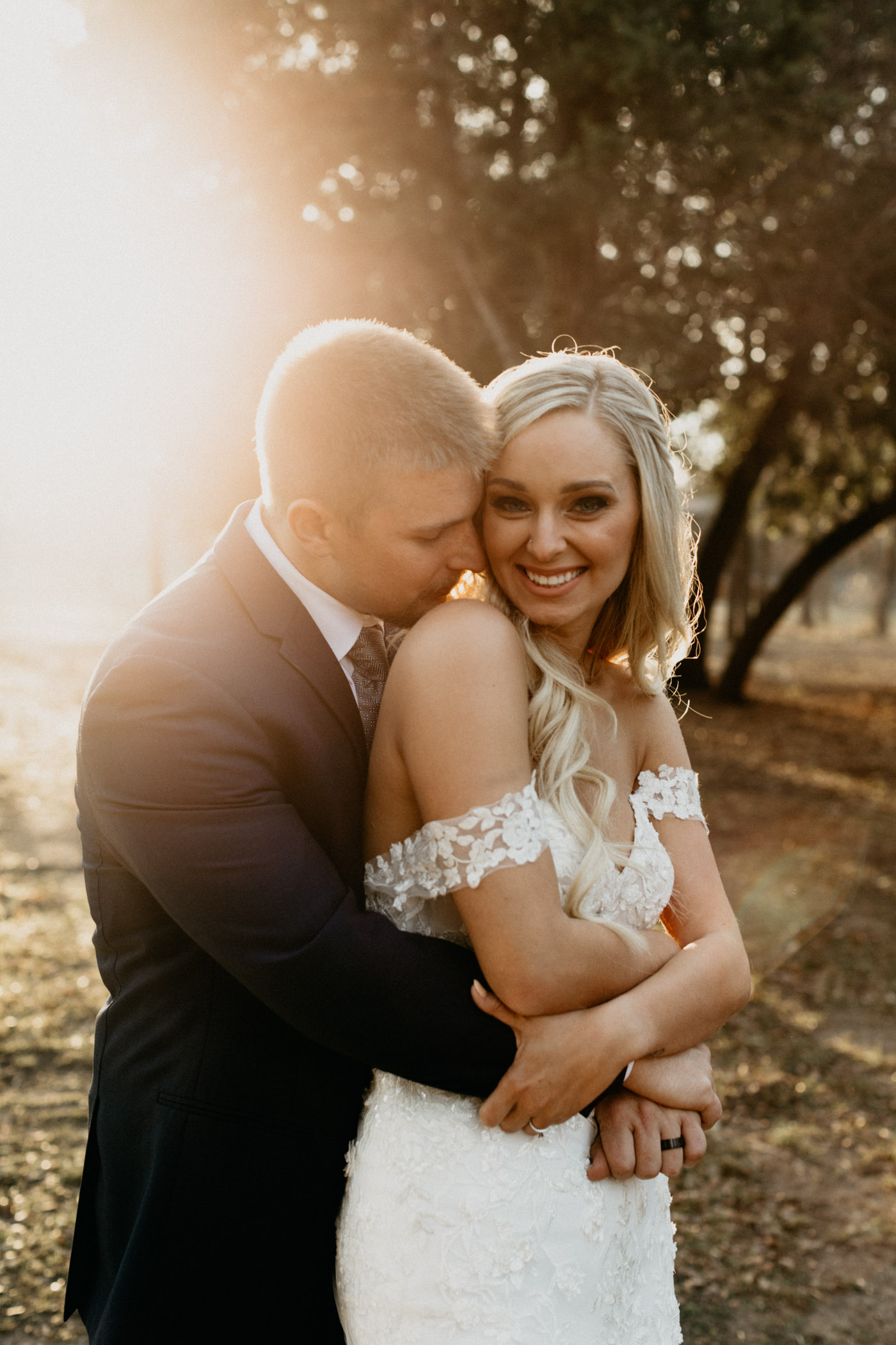 light leak photo of bride and groom snuggling after wedding