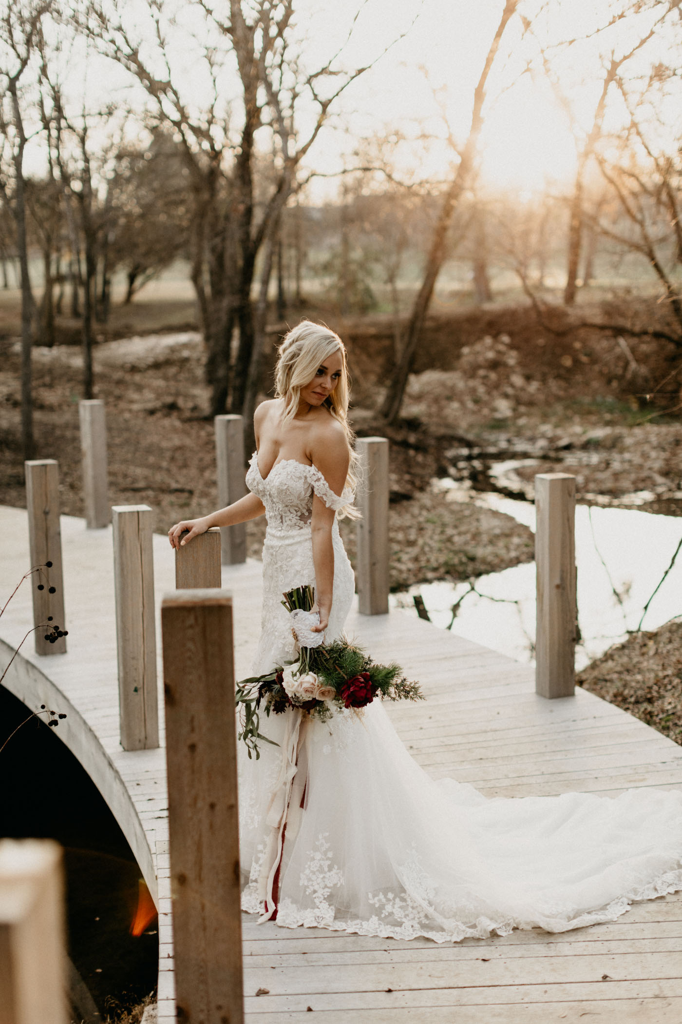 bride standing on bridge and looking over her shoulder