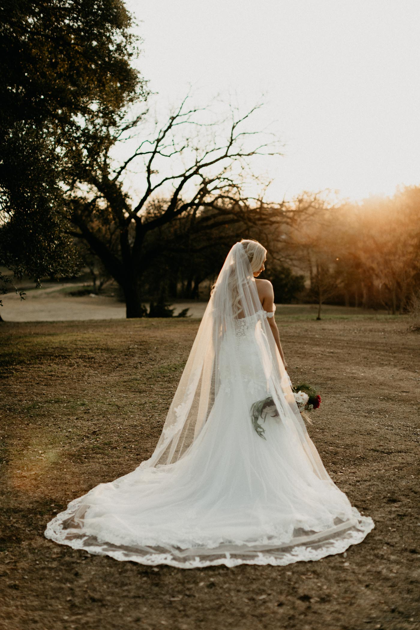 bride showing off her long wedding veil