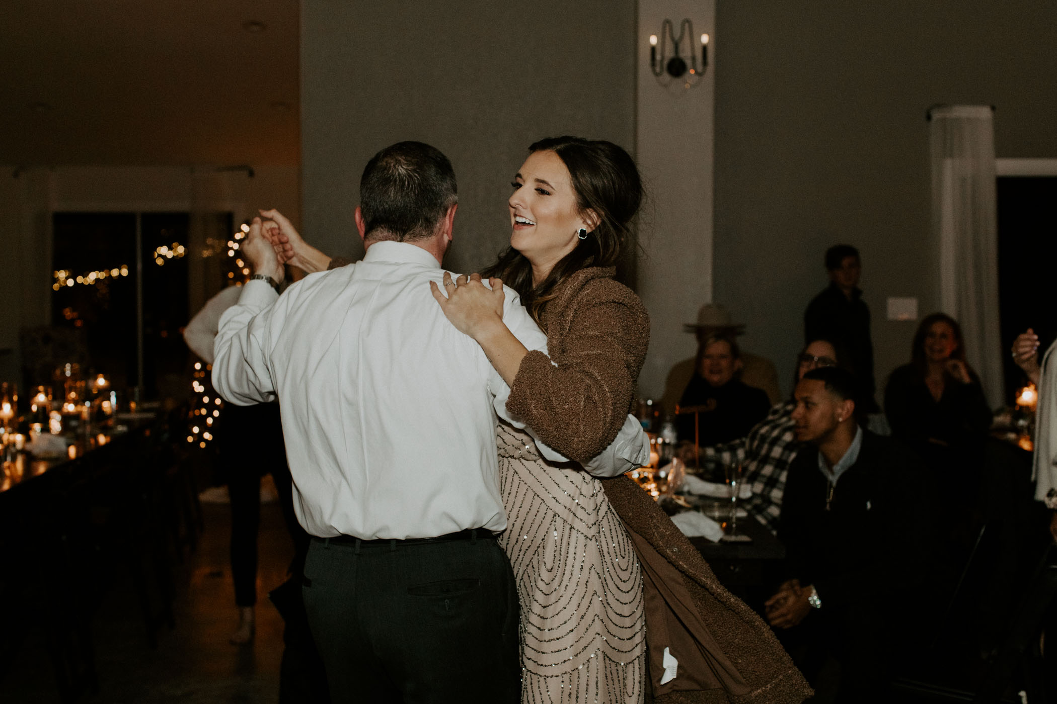 maid of honor dancing with dad on sisters winter wedding day