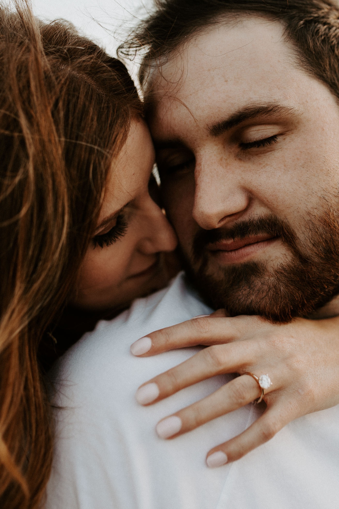 Close up photo of cute couple being romantic during engagement session