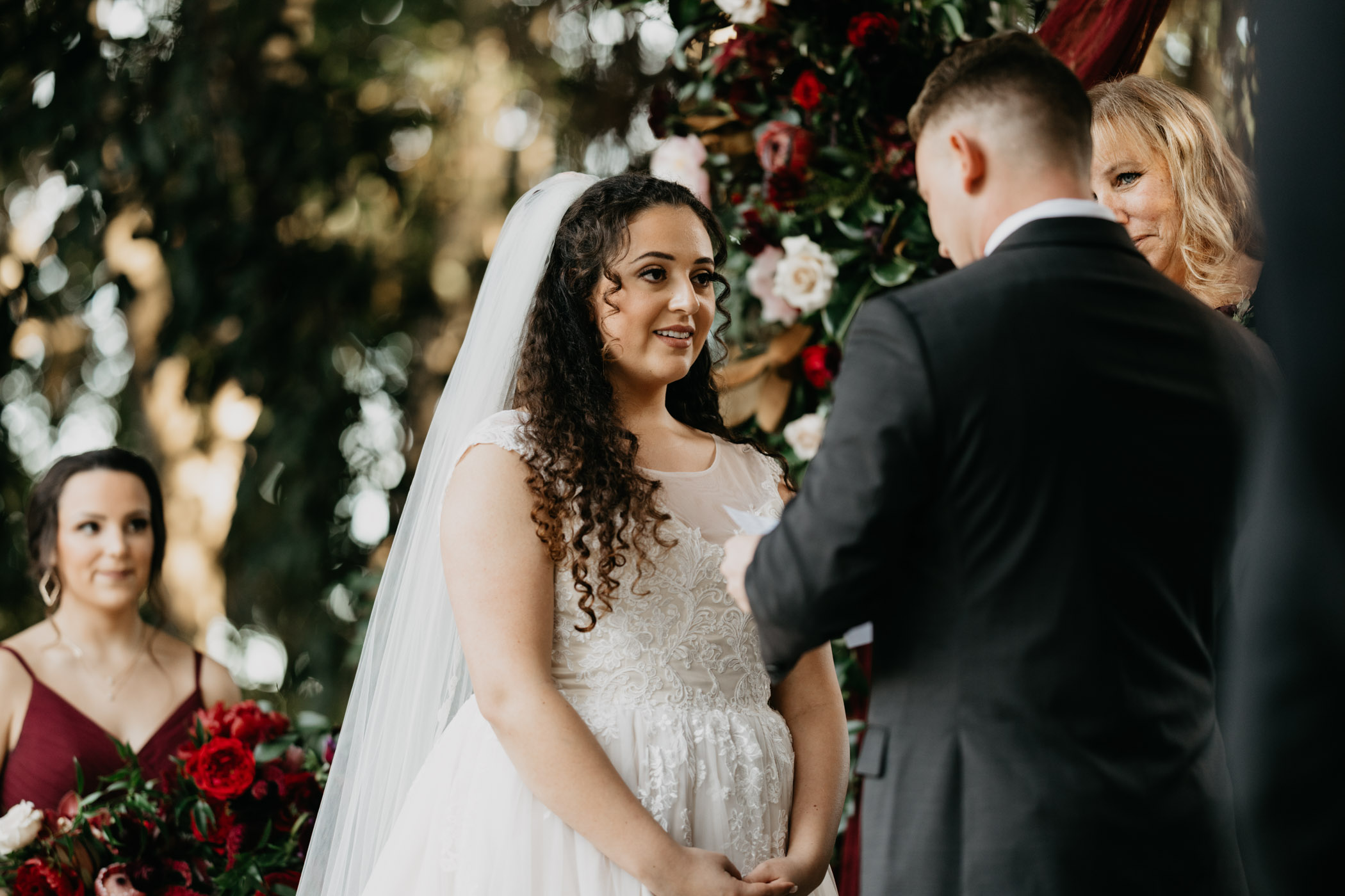 Bride standing at the altar looking at her soon to be husband