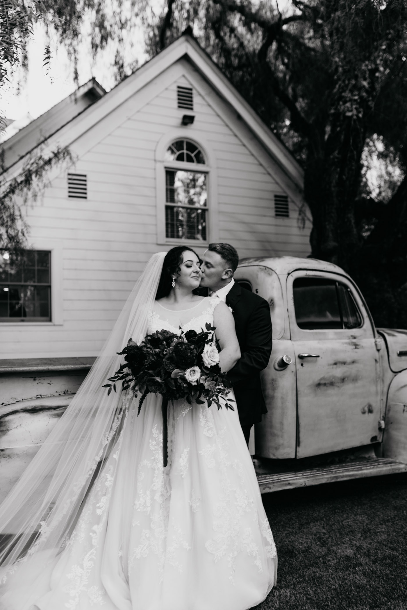 Black and white of bride and groom about to kiss