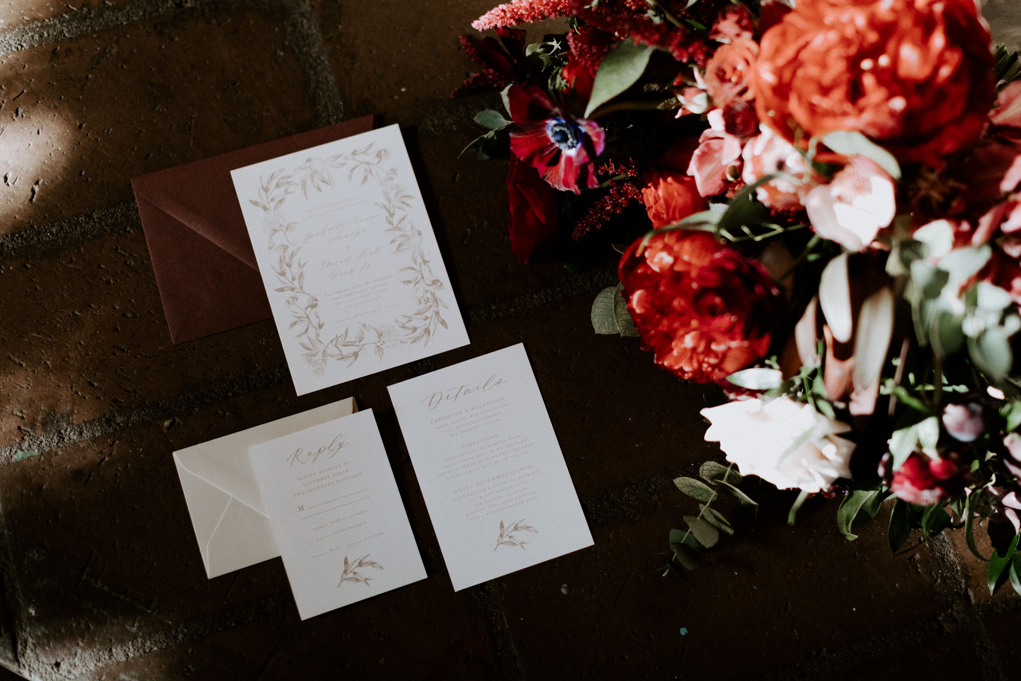 California wedding stationary detail photo with red flowers