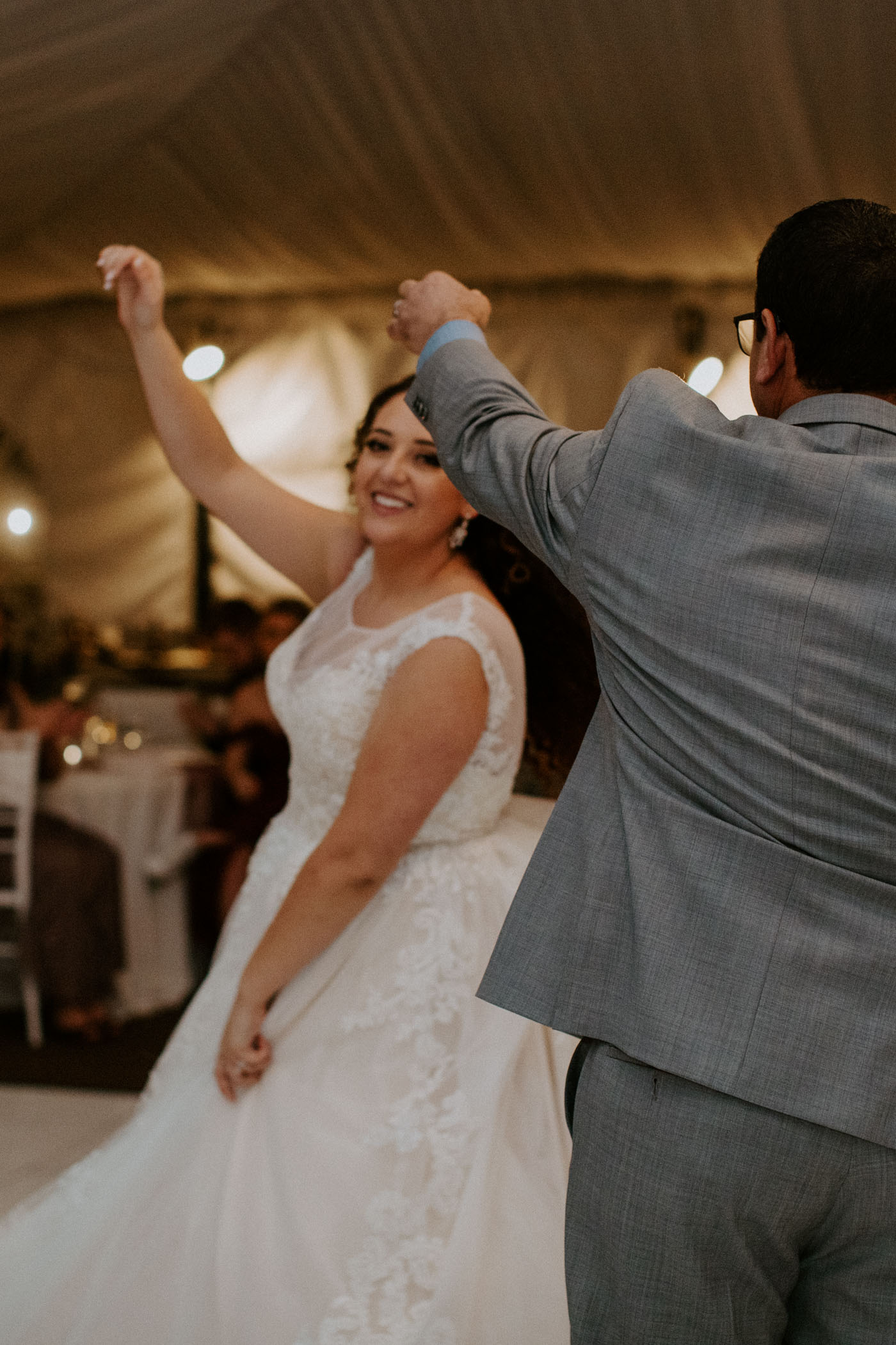 Dad dancing with his daughter on their wedding day