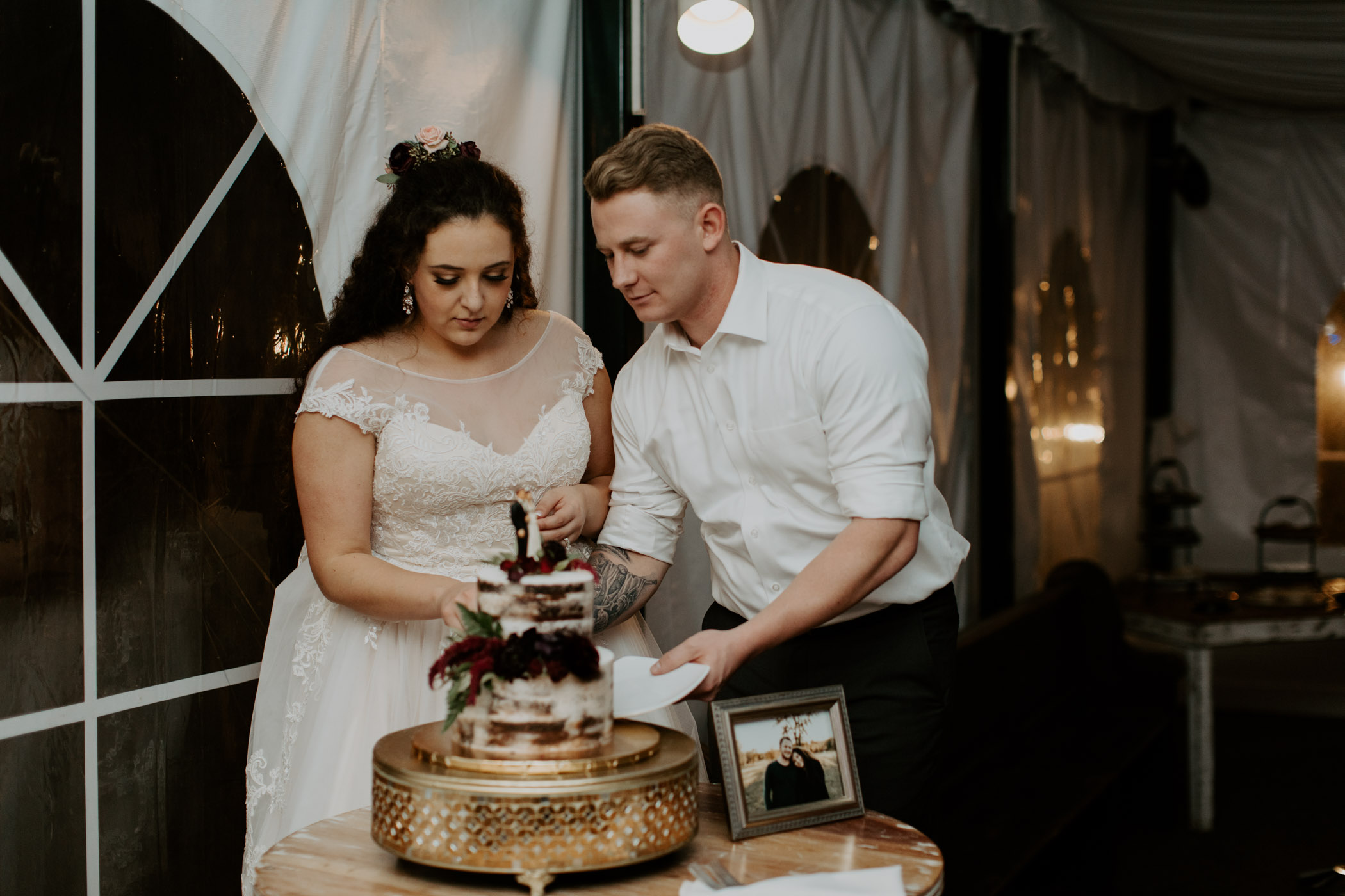 Bride and groom cutting the cake on their wedding day