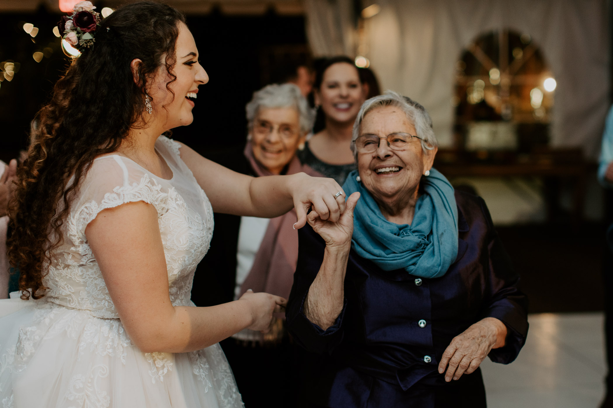 Bride dancing with grandma at wedding reception