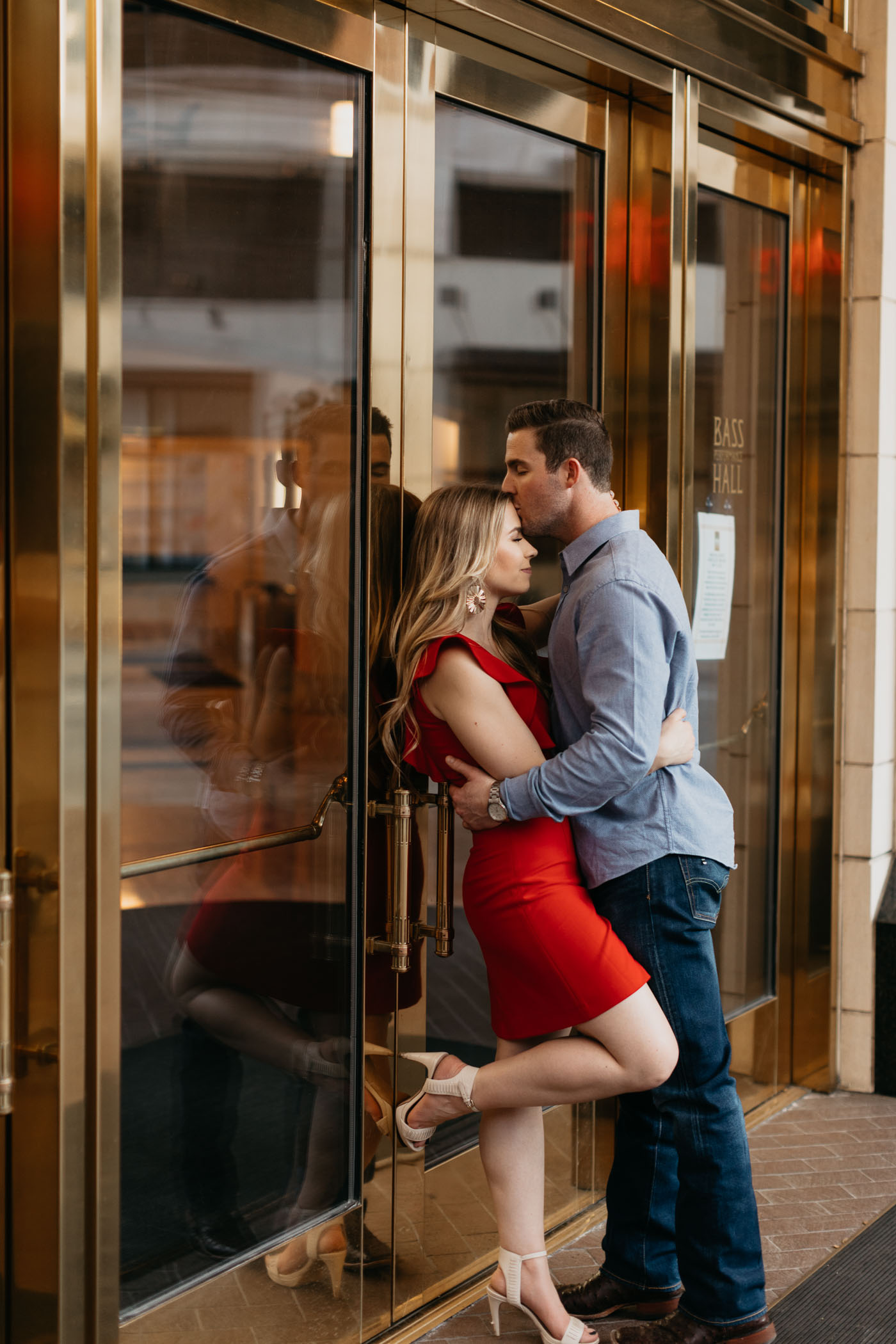 Chic engagement photo in front of bass hall in downtown fort worth