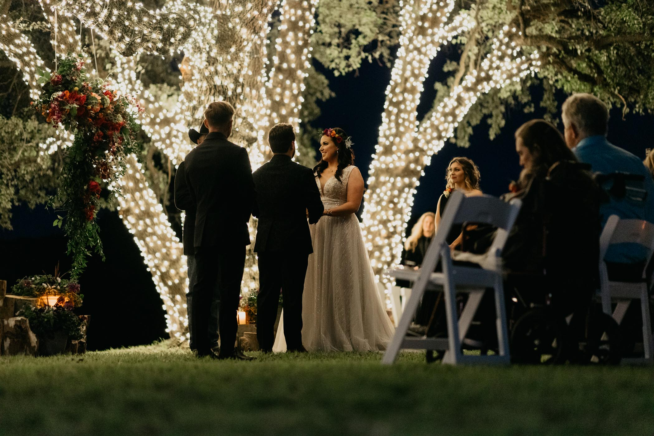 String lights lighting up wedding ceremony after dark