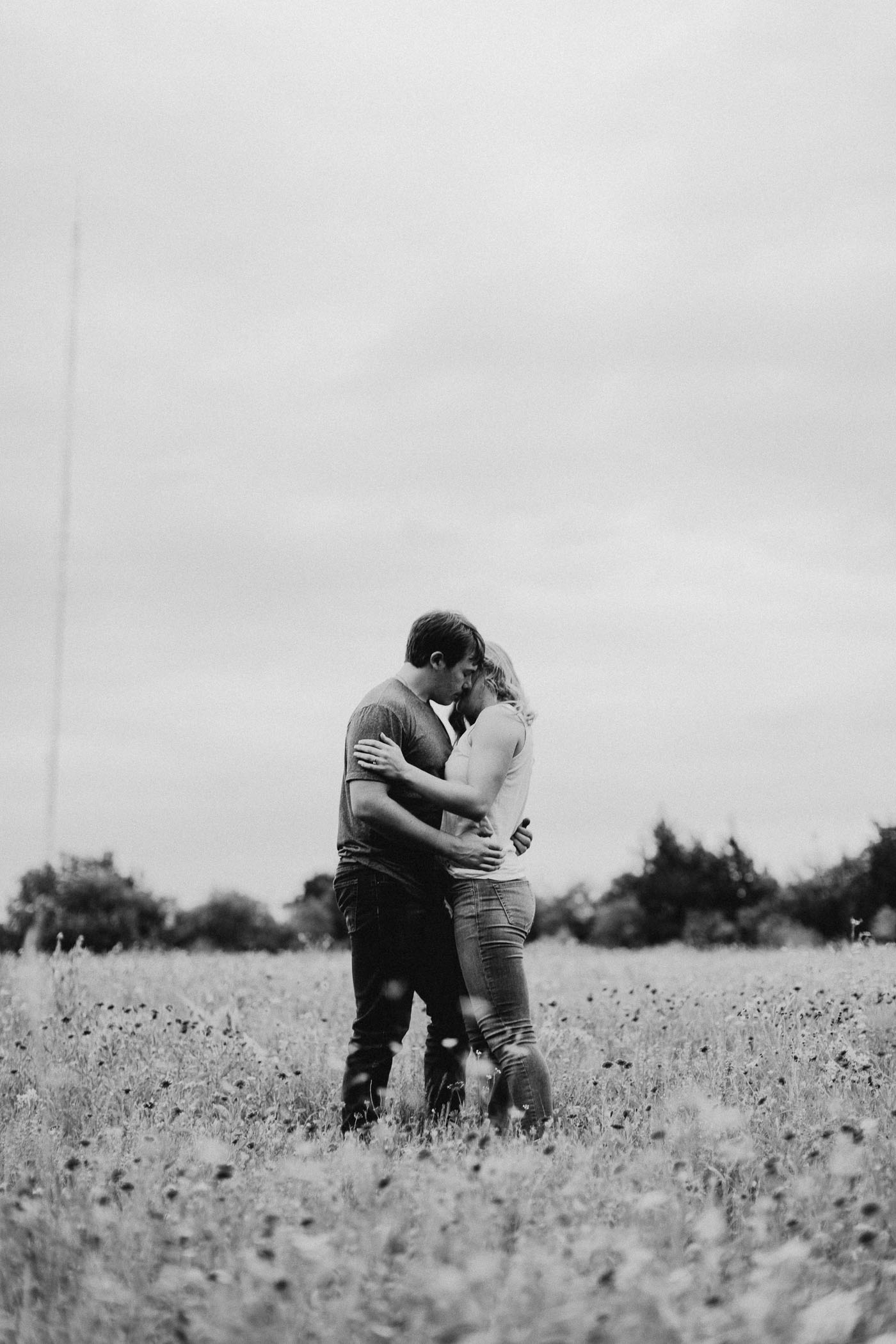 romantic black and white photo of engaged couple during photo session