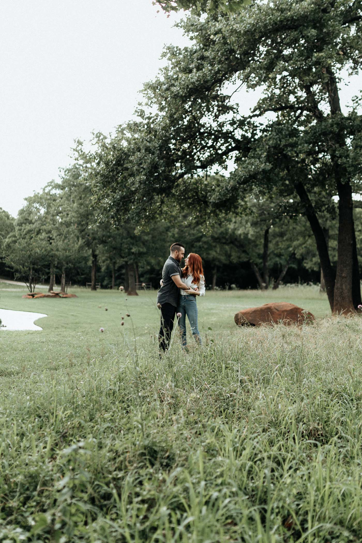 Romantic engagement photo of couple in DFW