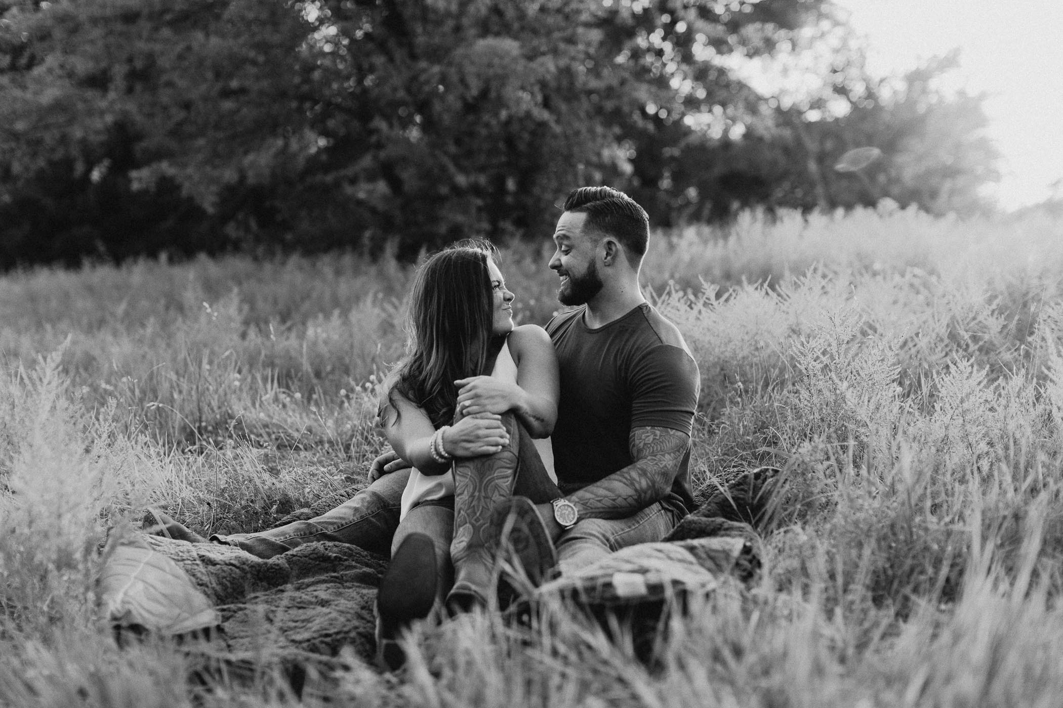 black and white of playful couple during sunset summer engagement session