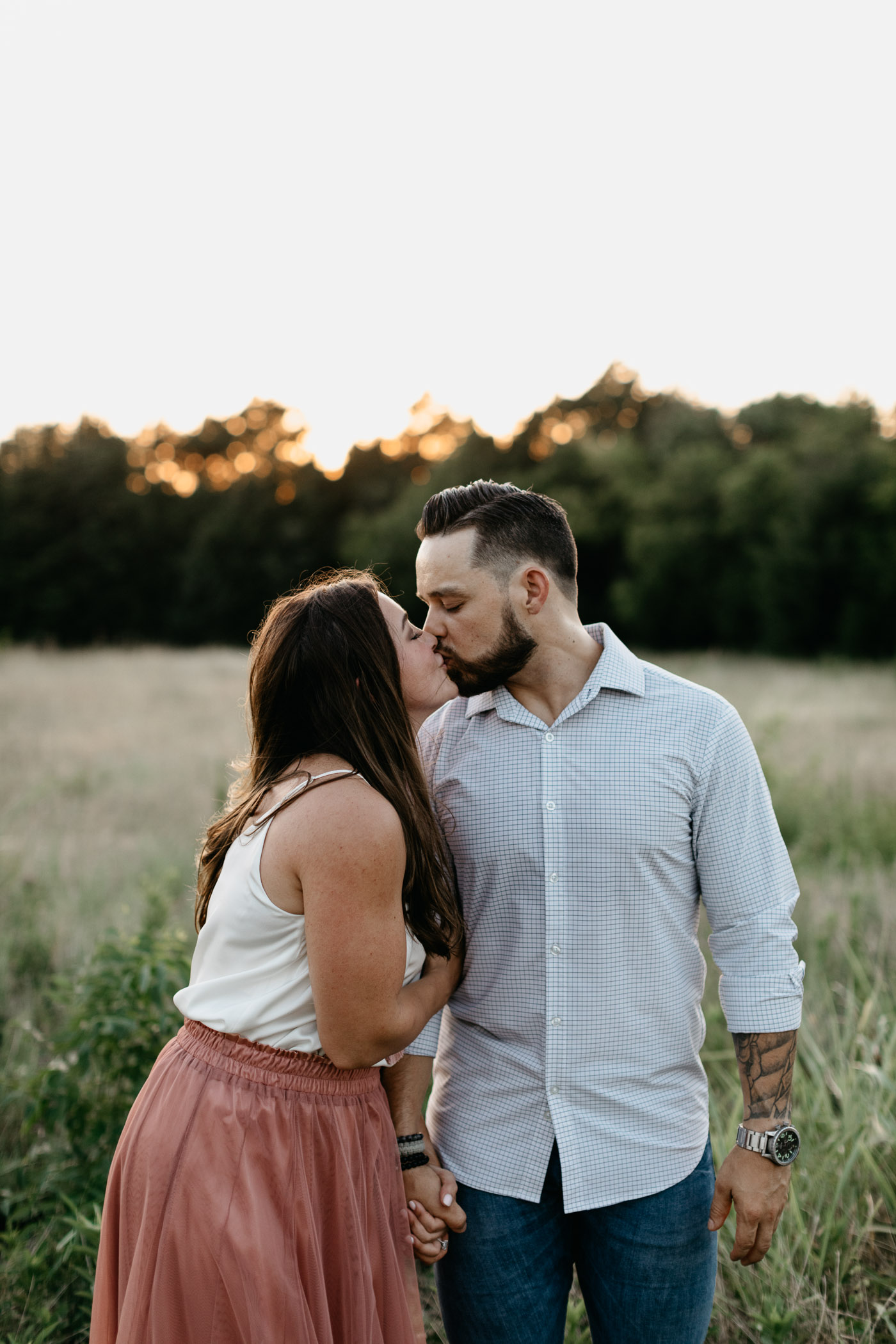 summer engagement session couple kissing in DFW