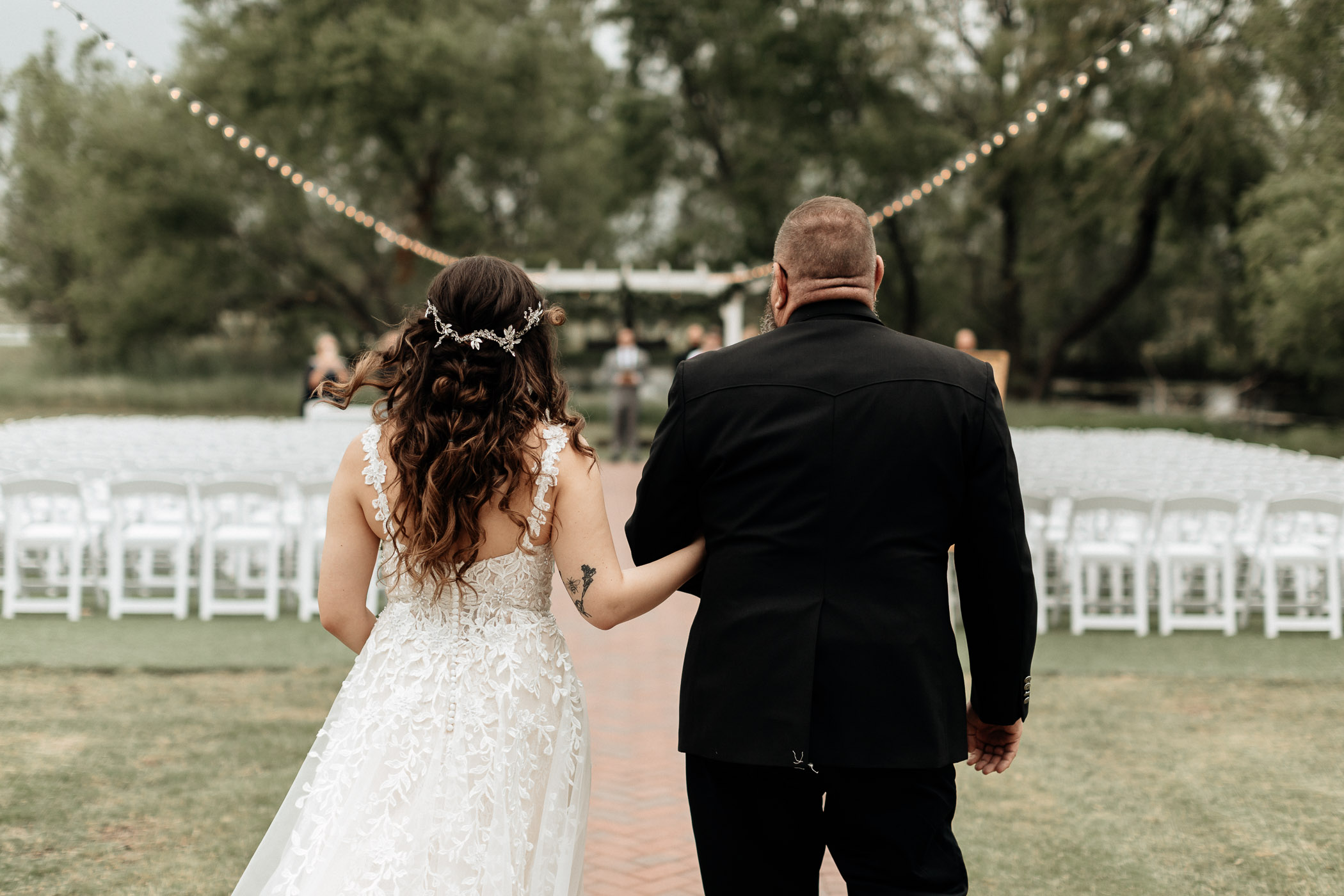 Brides dad walking her down the aisle on her wedding day in north Texas
