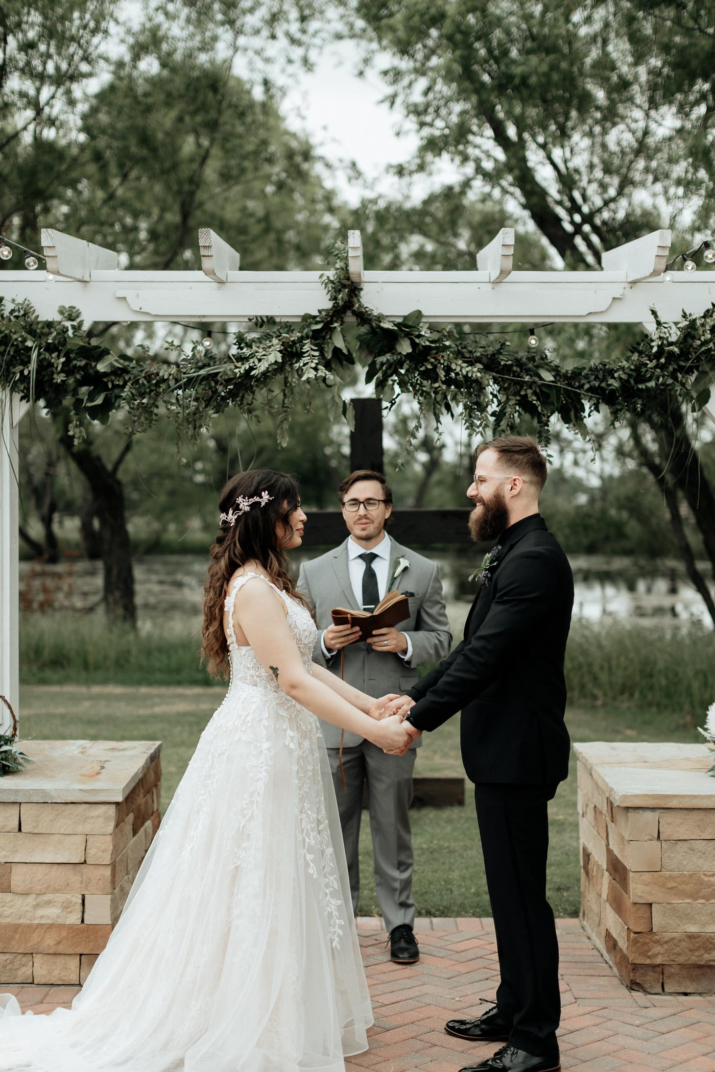Bride and groom standing at altar during outdoor wedding ceremony
