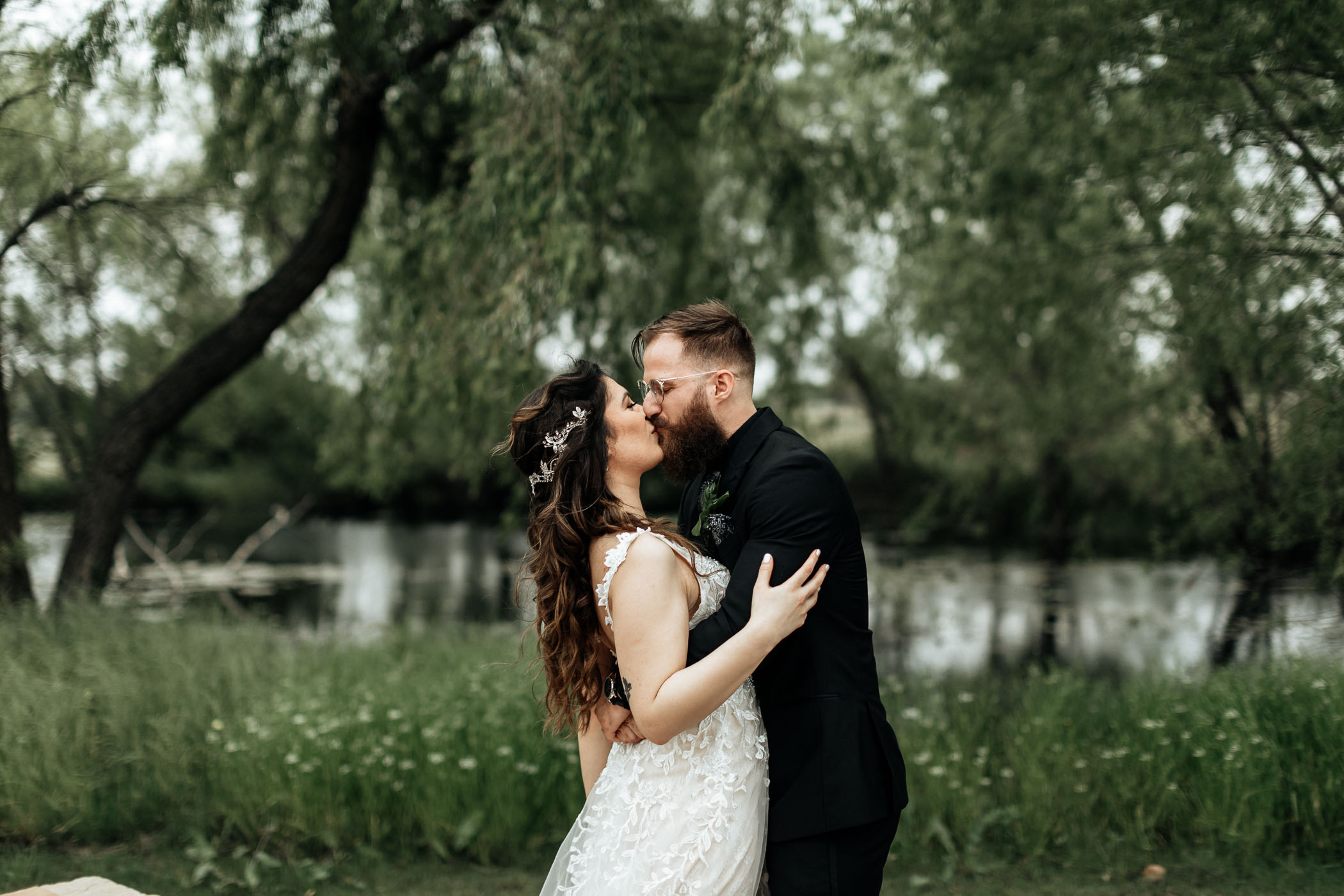 Bride and groom kissing for wedding portrait in DFW