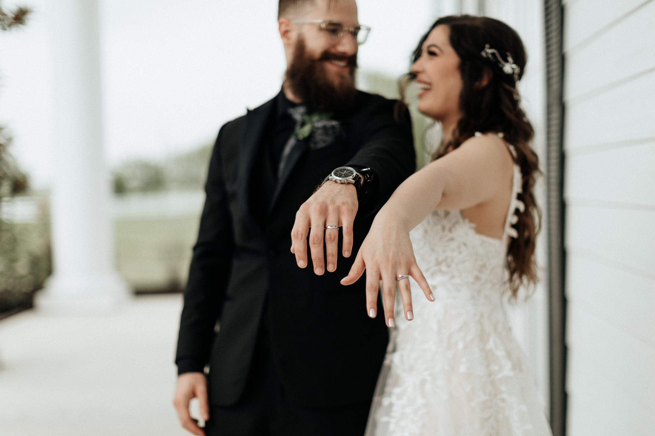 Bride and groom in DFW showing off their new wedding rings for photo