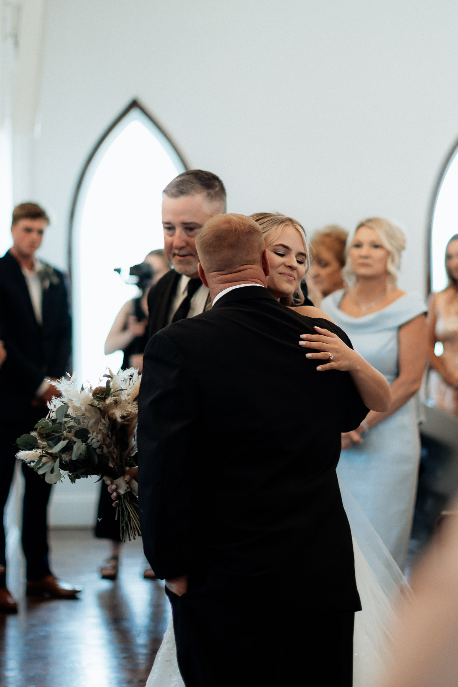 bride hugging her dad at the end of the aisle on her texas wedding day