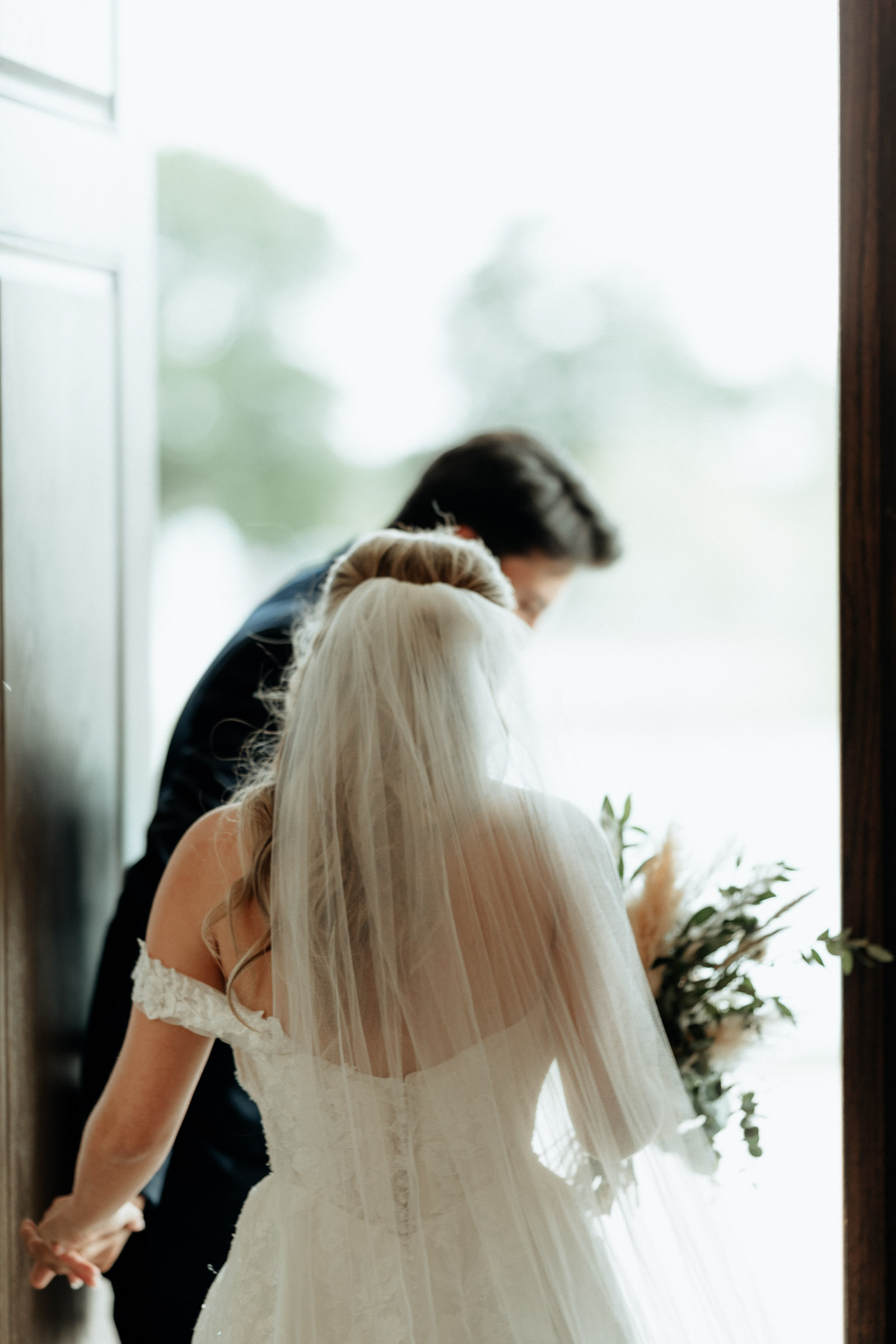 bride and groom leaving wedding chapel after wedding ceremony