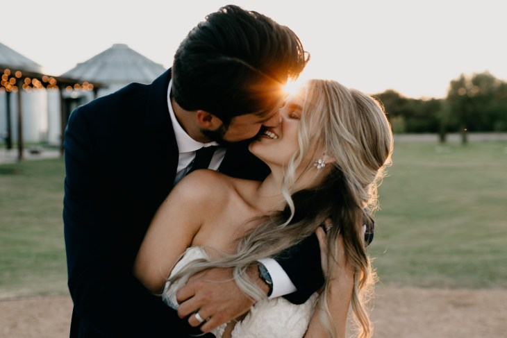 bride and groom kissing in DFW on their romantic wedding day