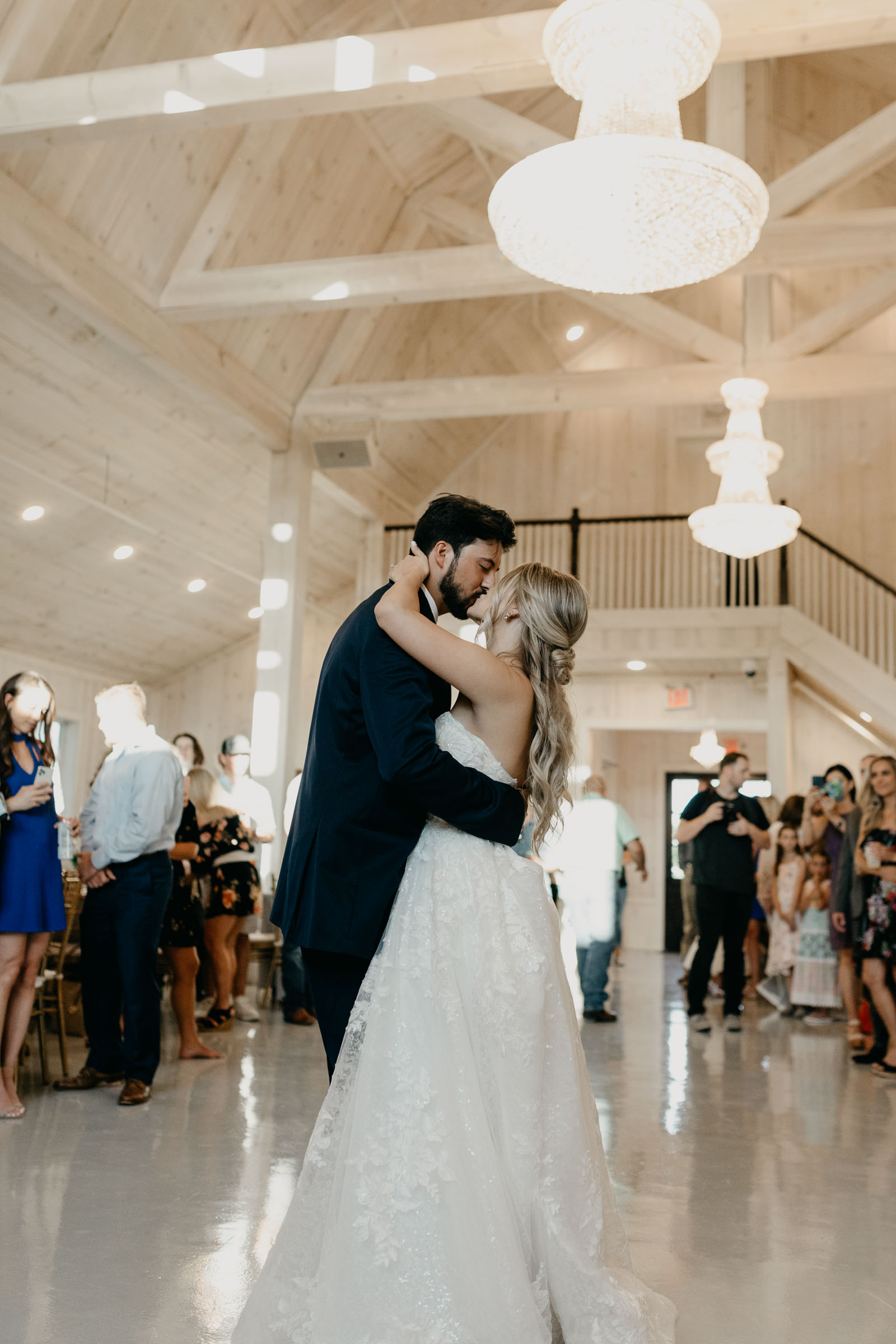 Bride and groom kissing at they share their first dance at one Preston events in DFW