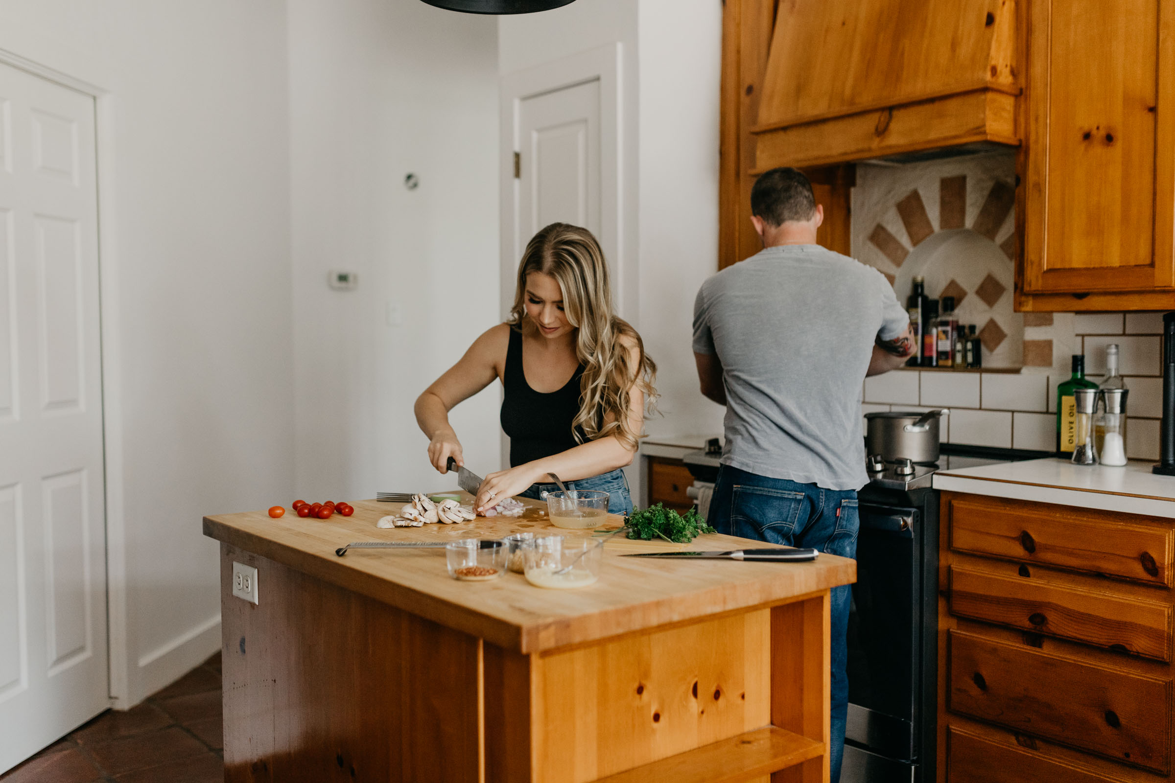 Adorable couple cooking dinner for date night