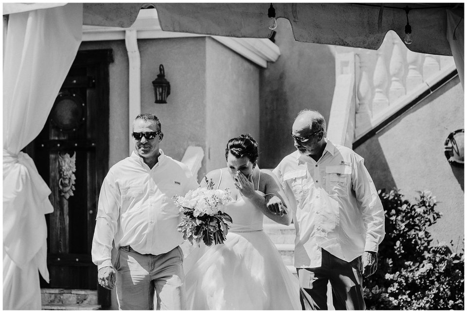 Bride escorted down the aisle by her dad and step dad