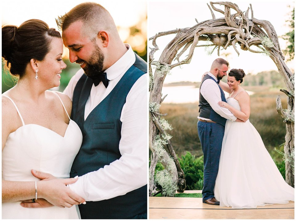 Bride and groom under driftwood arbor